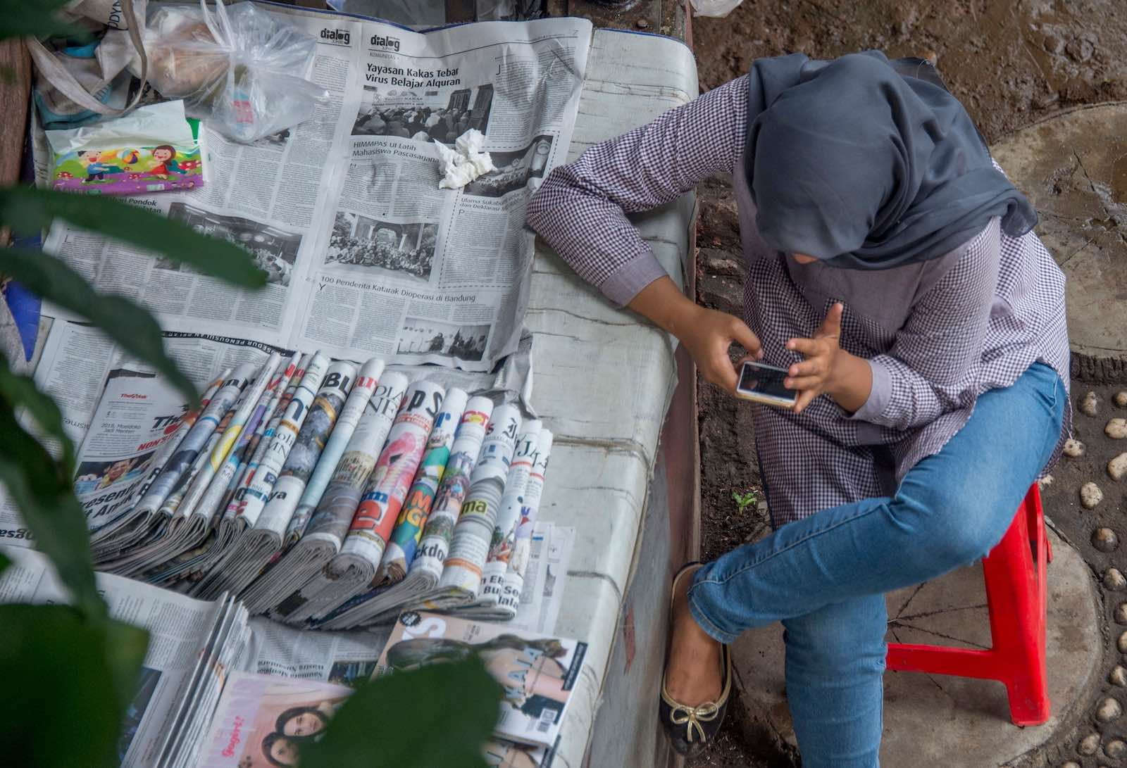 A newspaper vendor in Jakarta, Indonesia (Bay Ismoyo/AFP via Getty Images)