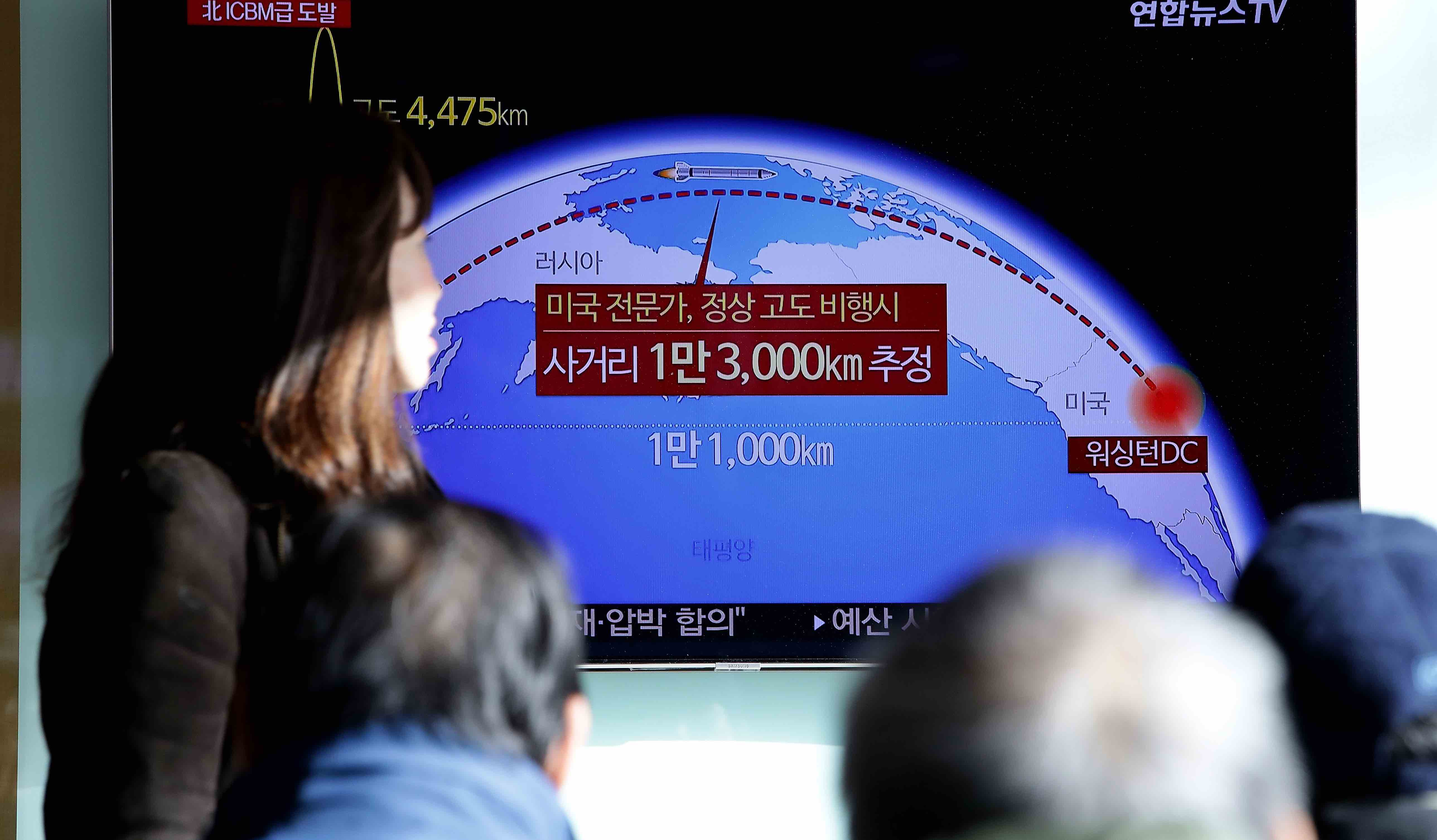 Television reports of North Korea's test-launch of a ballistic missile in November (Photo by Chung Sung-Jun/Getty)