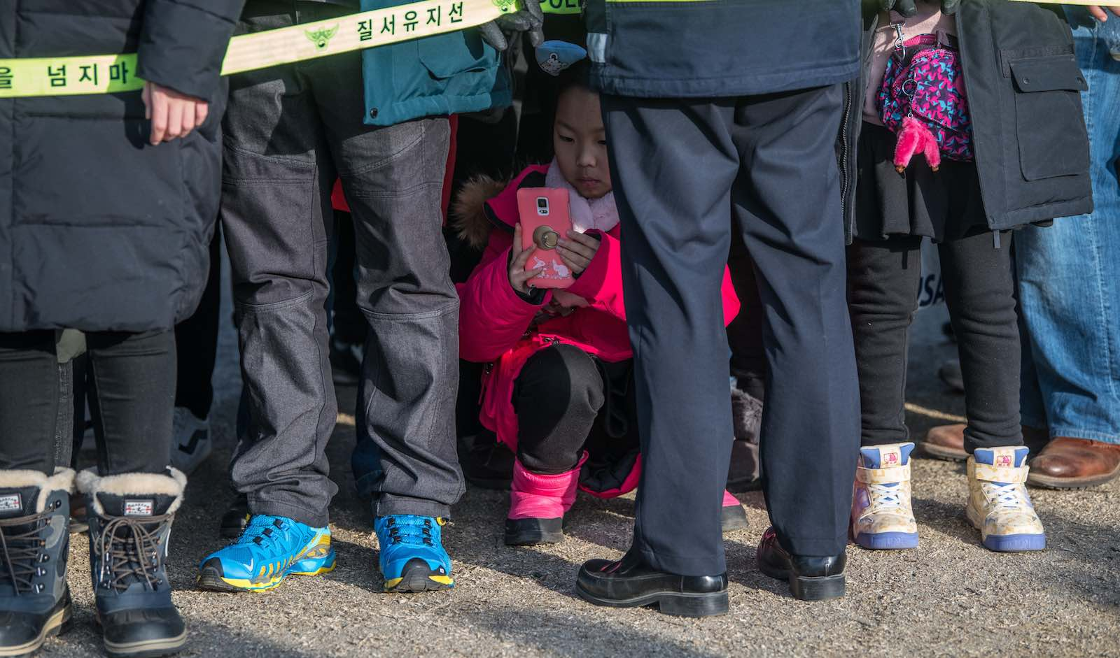 A girl crouches for a photograph during South Korea's PyeongChang Winter Olympics in February (Photo: Carl Court/Getty)