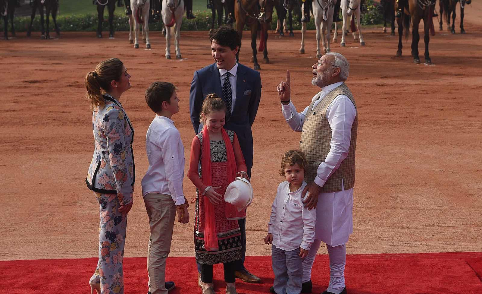 Indian Prime Minister Narendra Modi (right) welcoming Canadian Prime Minister Justin Trudeau and his family in New Delhi, 23 February 2018 (Vipin Kumar/Hindustan Times via Getty Images)