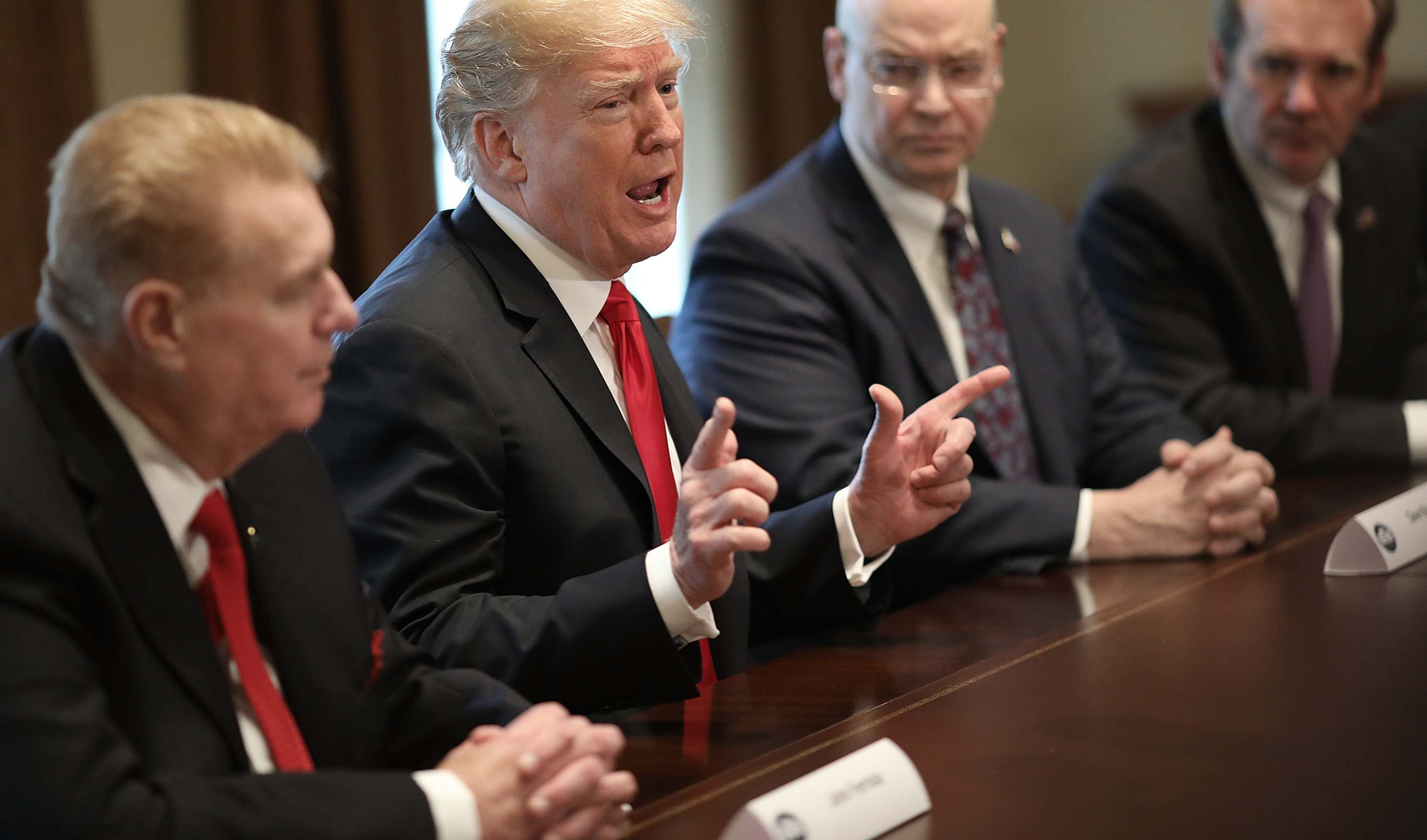 Donald Trump announces planned tariffs on imported steel and aluminium in a meeting with industry chiefs (Photo: Win McNamee/Getty)