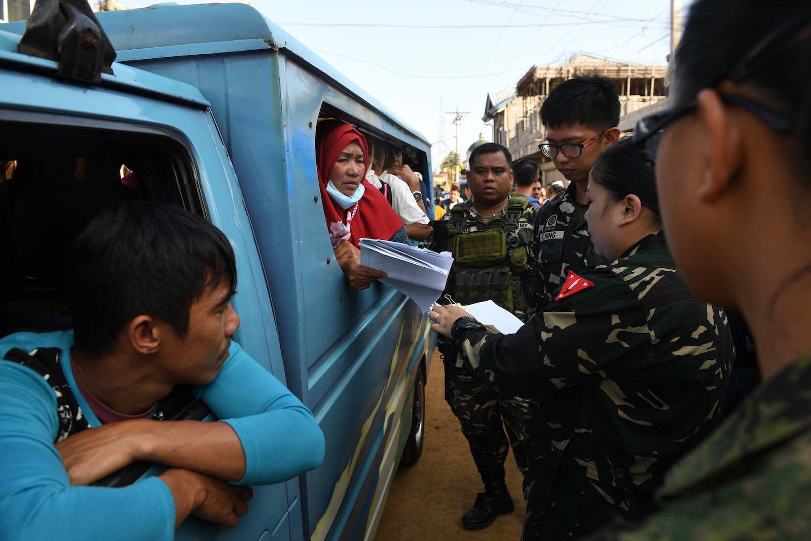 Soldiers check identity documents of residents allowed to visit their destroyed houses at the main battle area in Marawi City (Photo: Ted Aljibe/AFP/Getty Images)