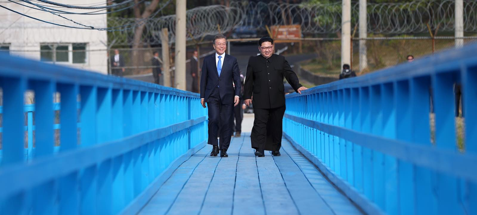 South Korean president Moon Jae-in and North Korean leader Kim Jong-un during their summit in April (Photo via Getty Images)