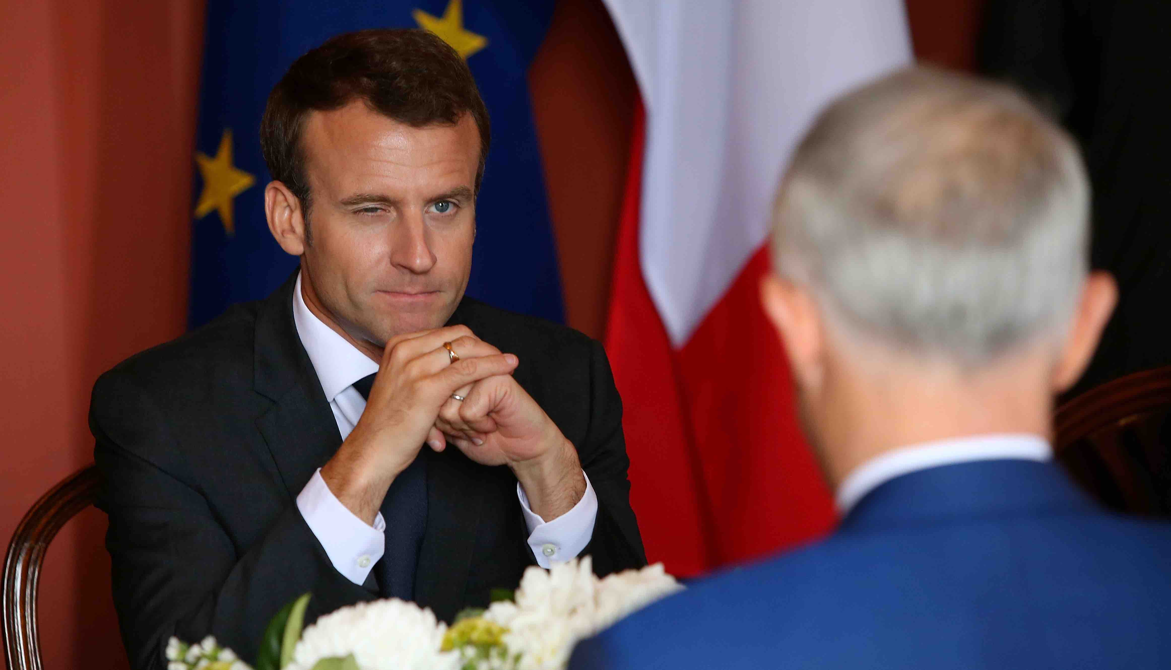 French President Emmanuel Macron speaks with Australia's Malcolm Turnbull on 2 May in Sydney (Photo: Jason McCawley via Getty)