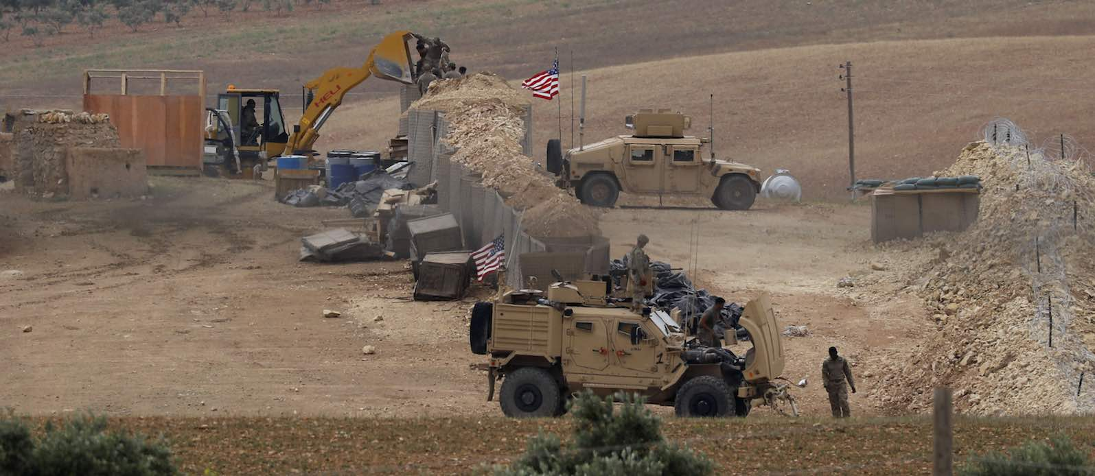 Vehicles and structures of US-backed coalition forces in the northern Syrian town of Manbij, in May (Photo: Delil Souleiman via Getty)