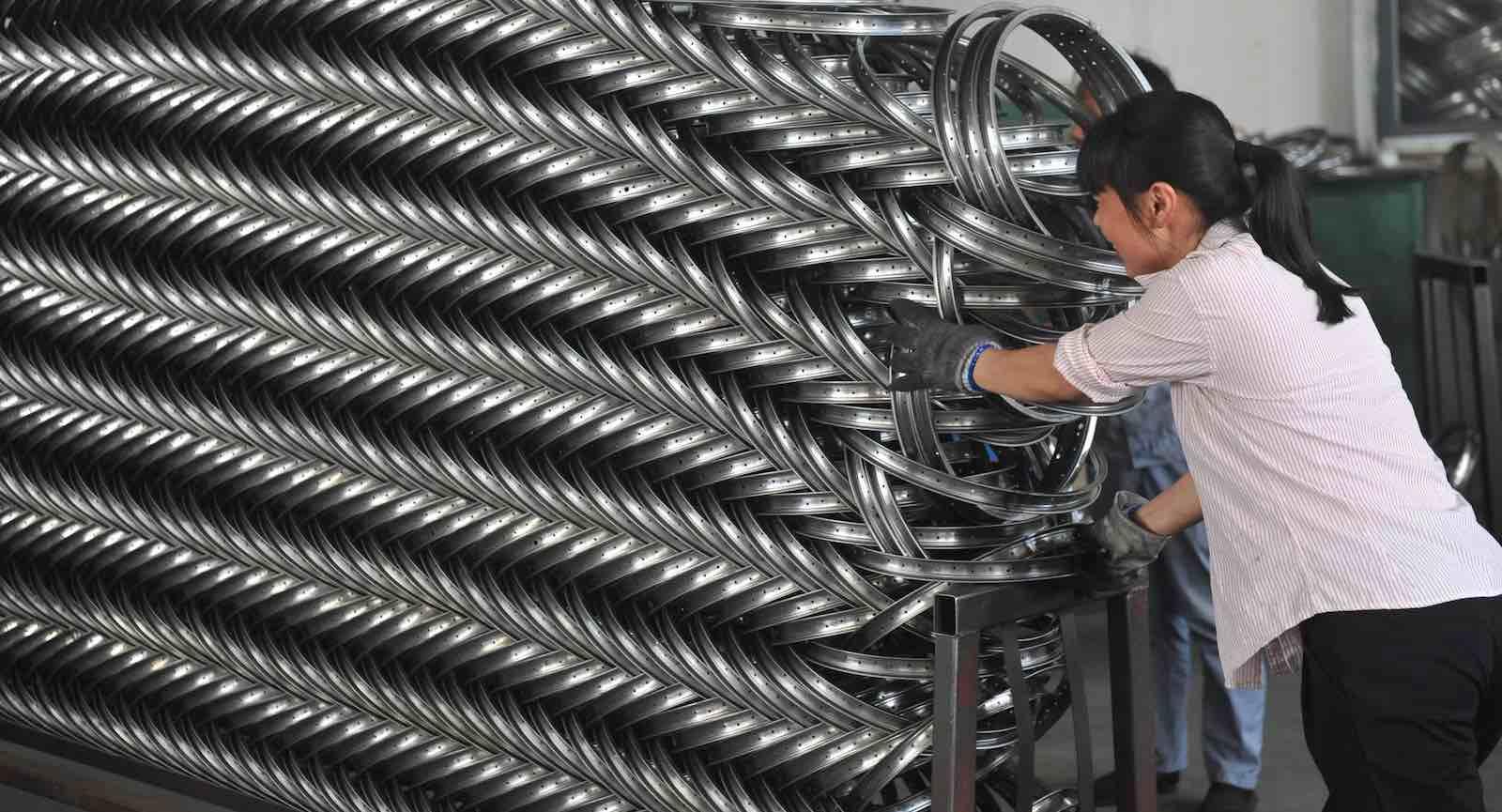 A steel wheel rims factory in Hangzhou, China (Photo: Barcroft Media via Getty)