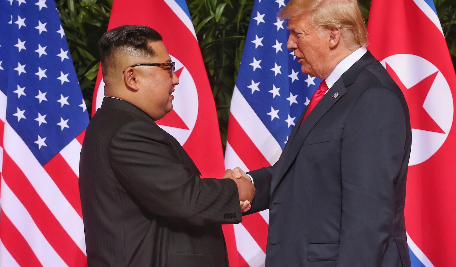 North Korean leader Kim Jong-un shakes hands with US President Donald Trump on Tuesday in Singapore (Photo: Kevin Lim via Getty)