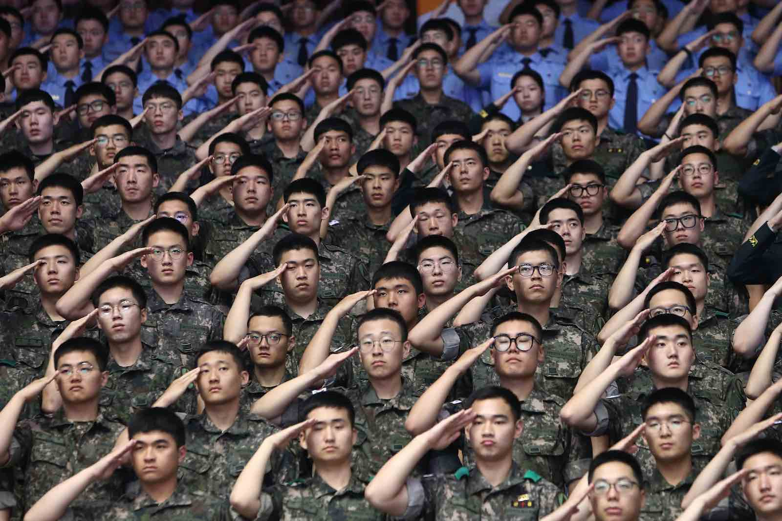 South Korean soldiers salute during a ceremony to mark the anniversary of the Korean War, 25 June (Photo: Chung Sung-Jun/Getty)