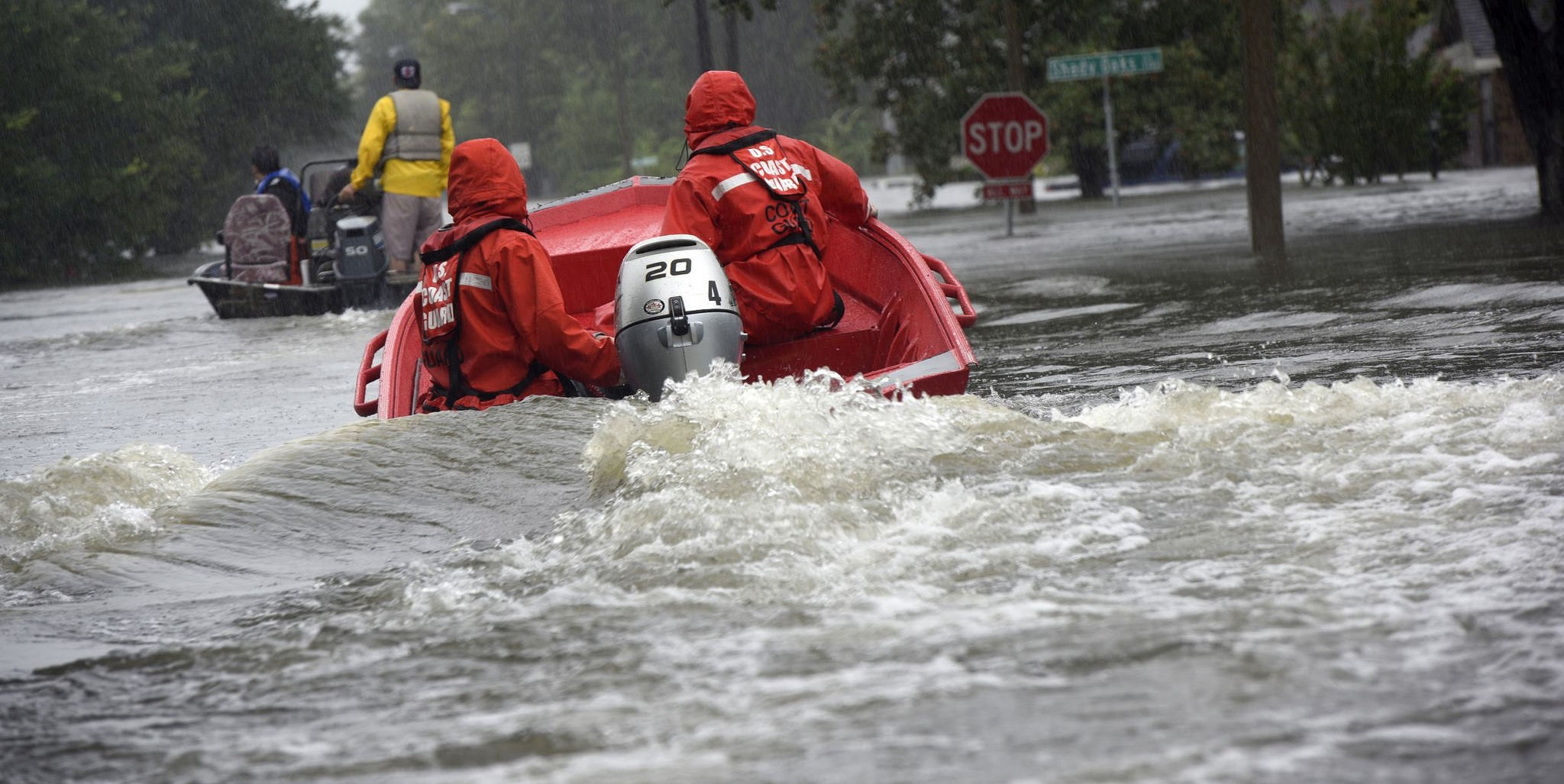 Coast Guard officers in a flood punt boat in Friendswood, Texas in the wake of Hurricane Harry (Photo:Coast Guard News/Flickr)