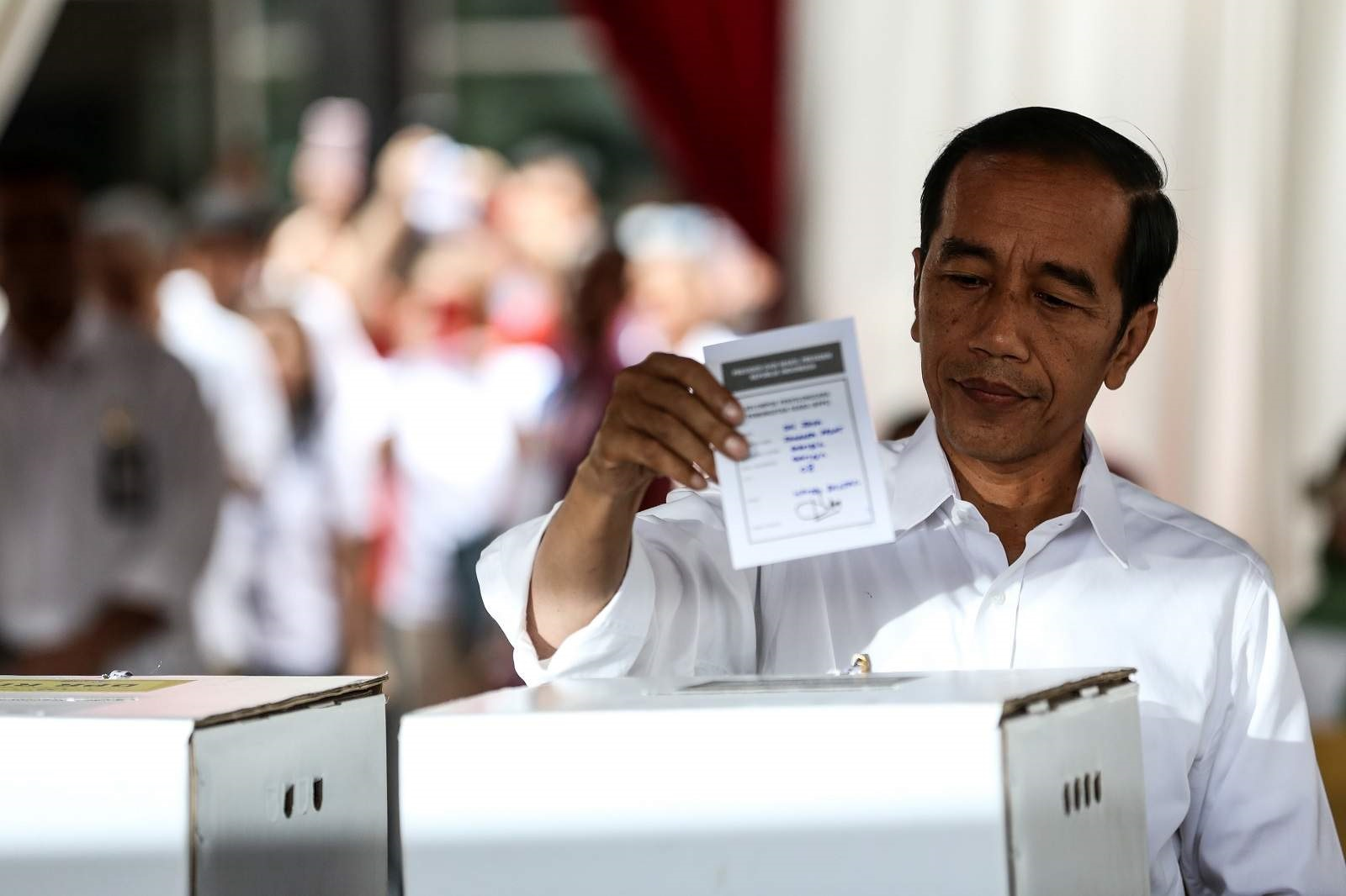 Indonesian President Joko Widodo votes during the 2019 election at a polling station in Jakarta, 17 April 2019 (Andrew Gal/NurPhoto via Getty Images)