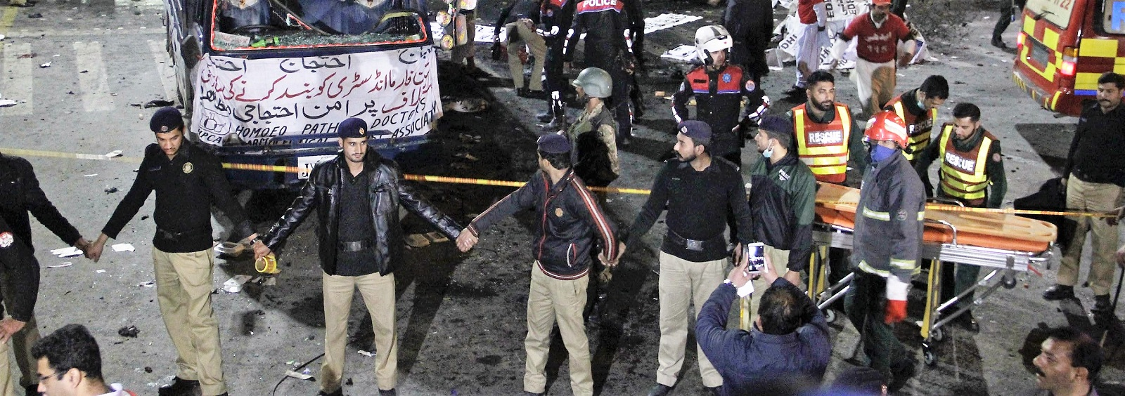 Pakistani security members at the site of Monday's bomb blast. (Photo:Rana Irfan Ali/Getty Images)