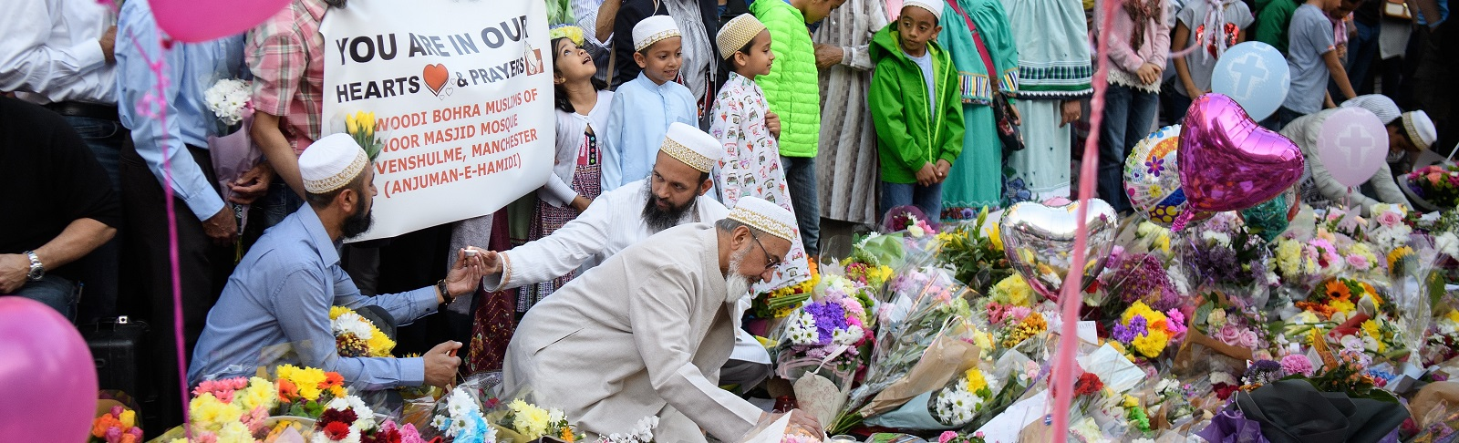 Members of Manchester's Muslim community were among those at public tributes to the victims and their families (Photo: Leon Neal/Getty)