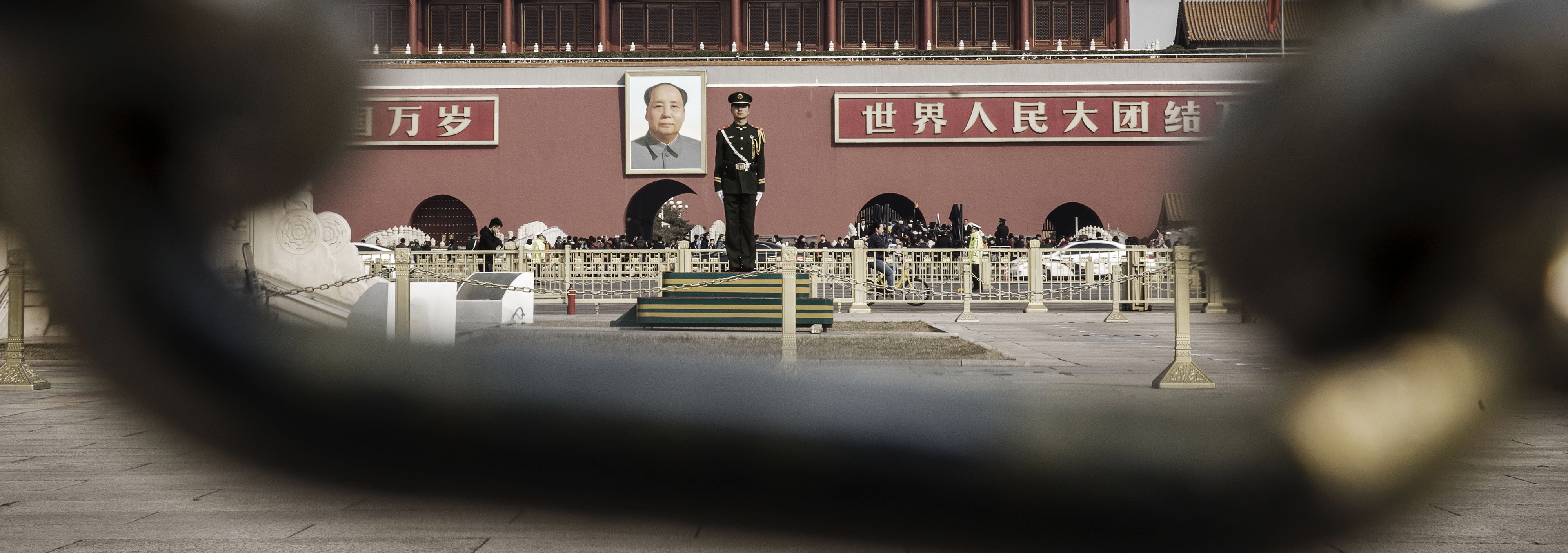 A member of the People's Armed Police in front of a portrait of former Chinese leader Mao Zedong at the Tiananmen Gate in Beijing (Photo: Qilai Shen/via Getty Images)