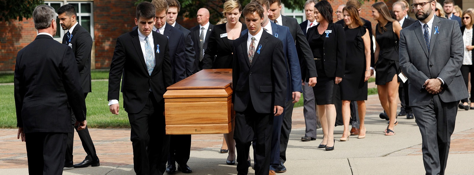 The casket of Otto Warmbier is carried out from his funeral on 22 June in Wyoming, Ohio. (Photo:Bill Pugliano/Getty Images)