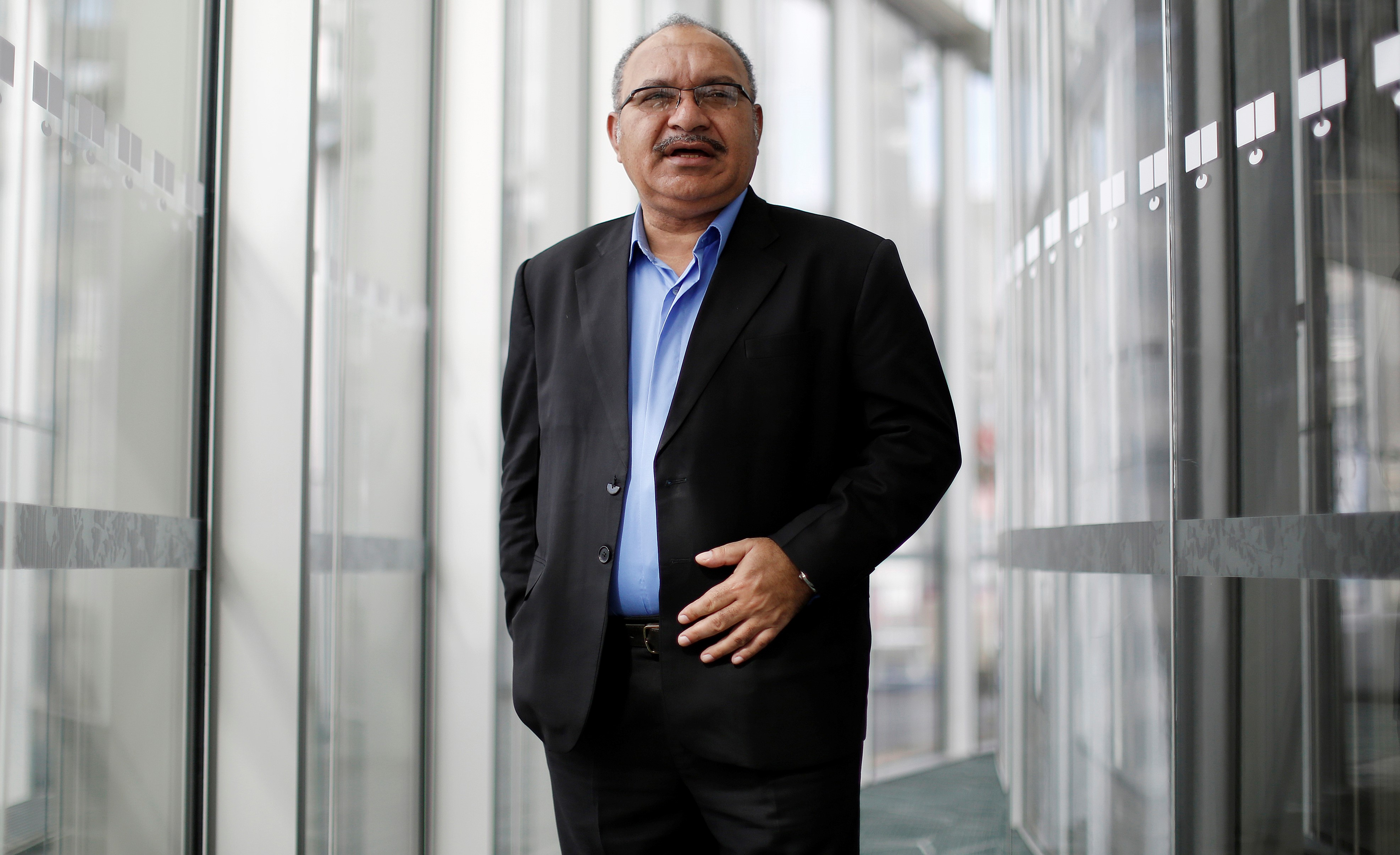 PNG's most recent PM Peter O'Neill has retained his seat in the recent election and his party is forecast to be called on to form government. (Photo: David Moir/ via Getty Images)