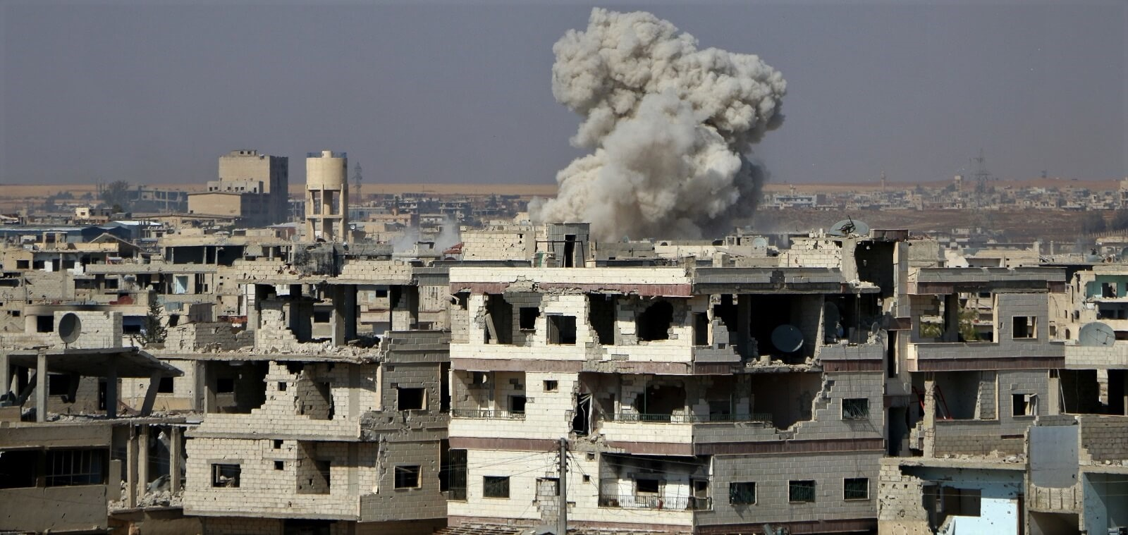 Smoke rises after attacks by the Assad regime on Daraa, Syria (Photo: Muhammed Yusuf via Getty)