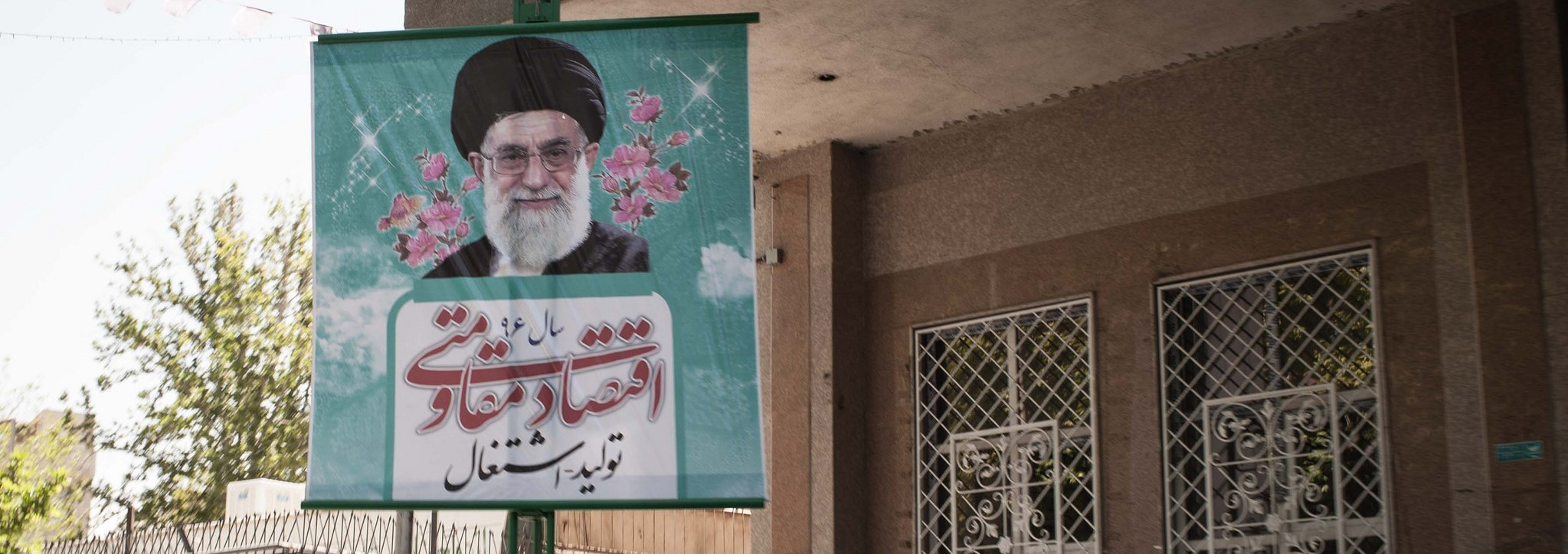 Poster of the re-elected Iranian president Hassan Rouhani (Photo: Flickr/ Evgeniy Isaev)