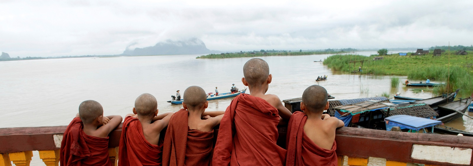 Buddhist novices at a small port on the Salween River in Karen State, Myanmar (Photo: Thierry Falise/via Getty Images)