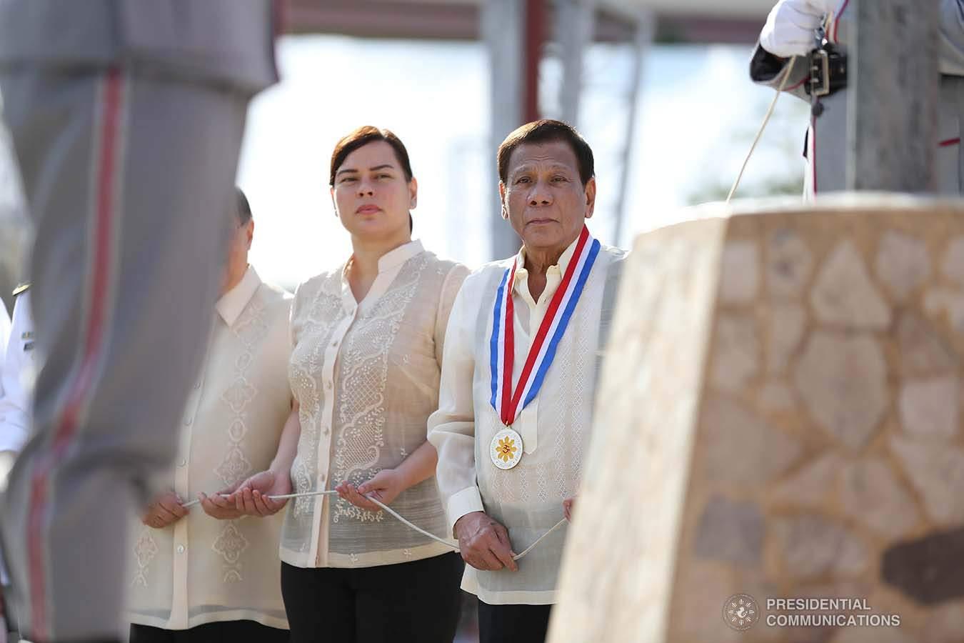 President Rodrigo Duterte leads a flag-raising ceremony with his daughter, Davao City Mayor Sara Duterte-Carpio, in Davao City, 30 December 2019 (Karl Norman Alonzo/Presidential Communications Operations Office)