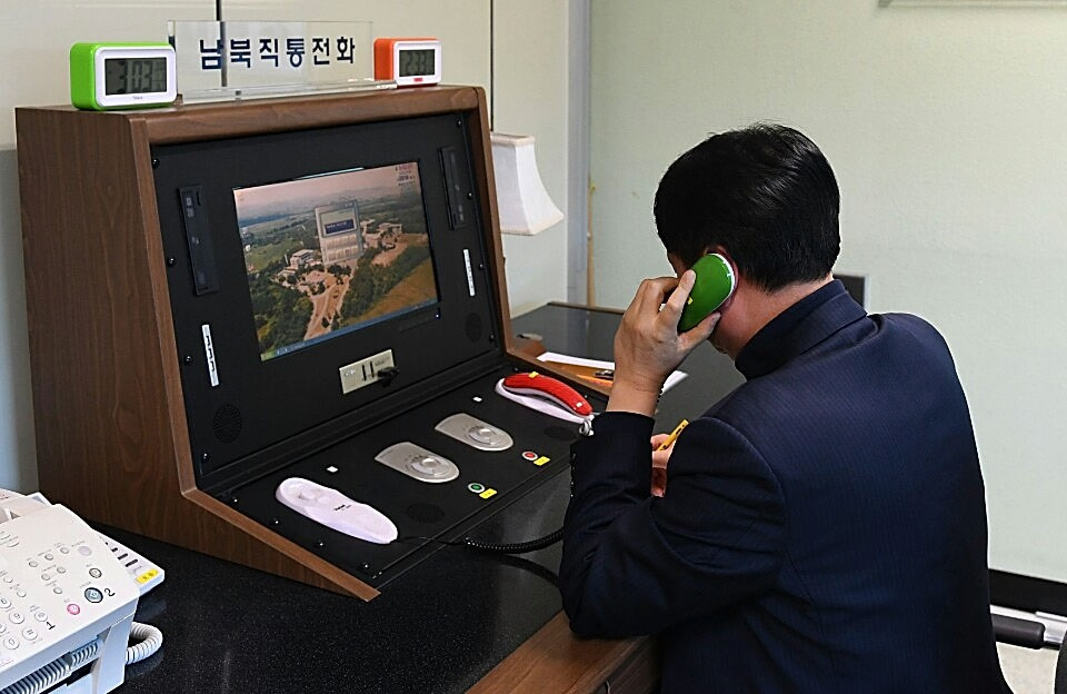 A South Korean official checks the direct communications hotline to talk with the North Korean side in 2018. After a period of radio silence, the hotline reportedly reopened again in late July 2021 (South Korean Unification Ministry/Getty Images)