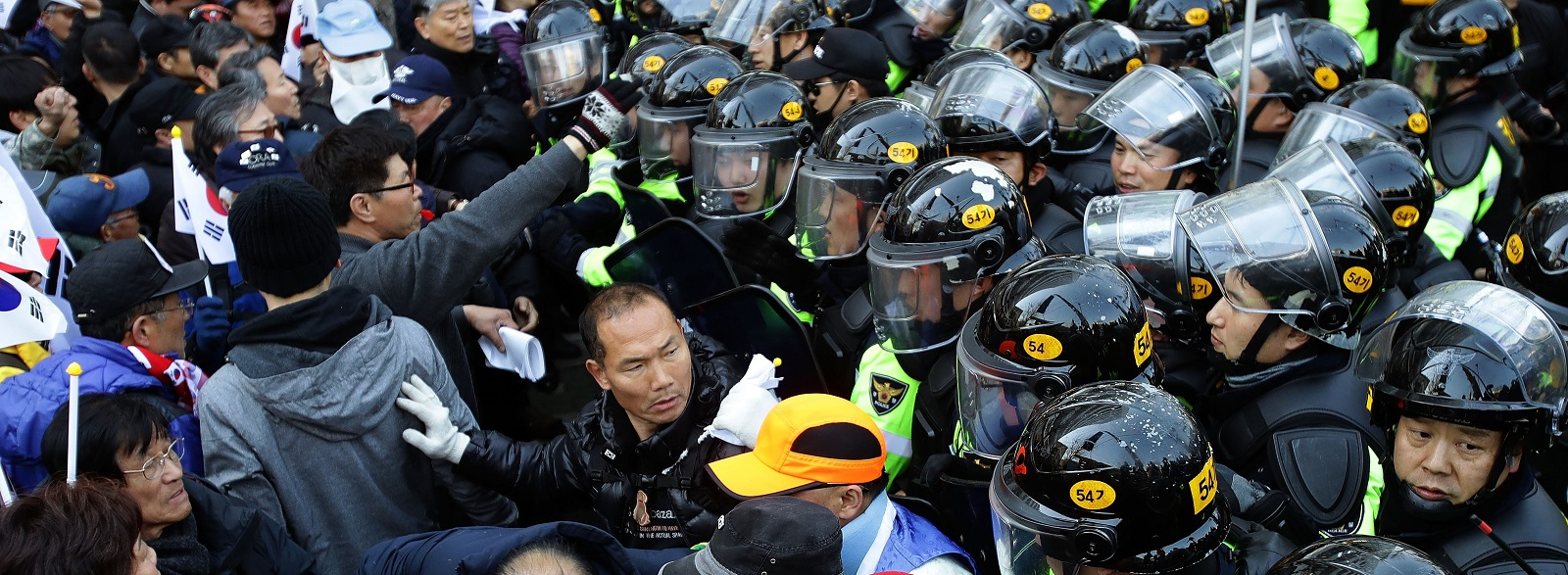 Supporters of Park Geun-hye are blocked by police after a rally in Seoul opposing her impeachment on 10 March. (Photo: Chung Sung-Jun/Getty Images)
