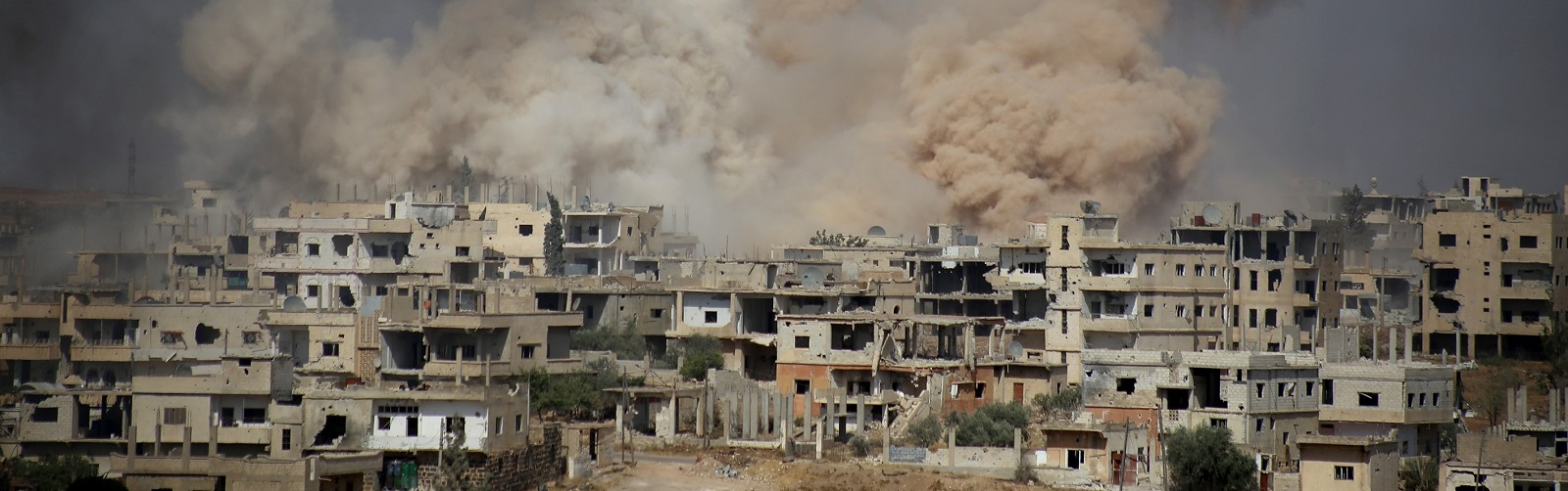 Assad regime hits residential areas in the contested city of Daraa, 14 June (Photo: Anadolu Agency/Getty)