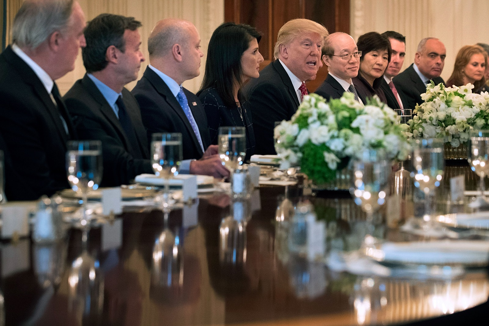 President Trump with the US Ambassador to the UN Nikki Haley and other UN Security Council members at the White House in April (Photo: Chip Somodevilla/Getty Images