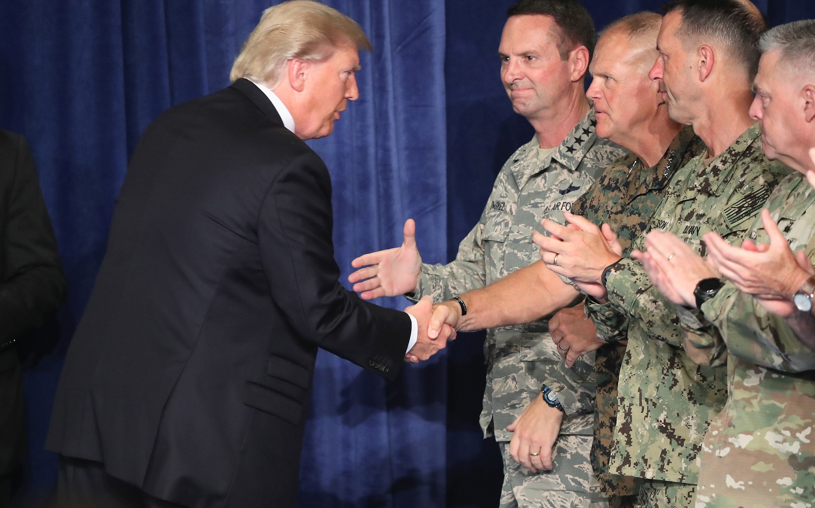 President Donald Trump greets military leaders before his speech on Afghanistan. (Photo by Mark Wilson/Getty Images)