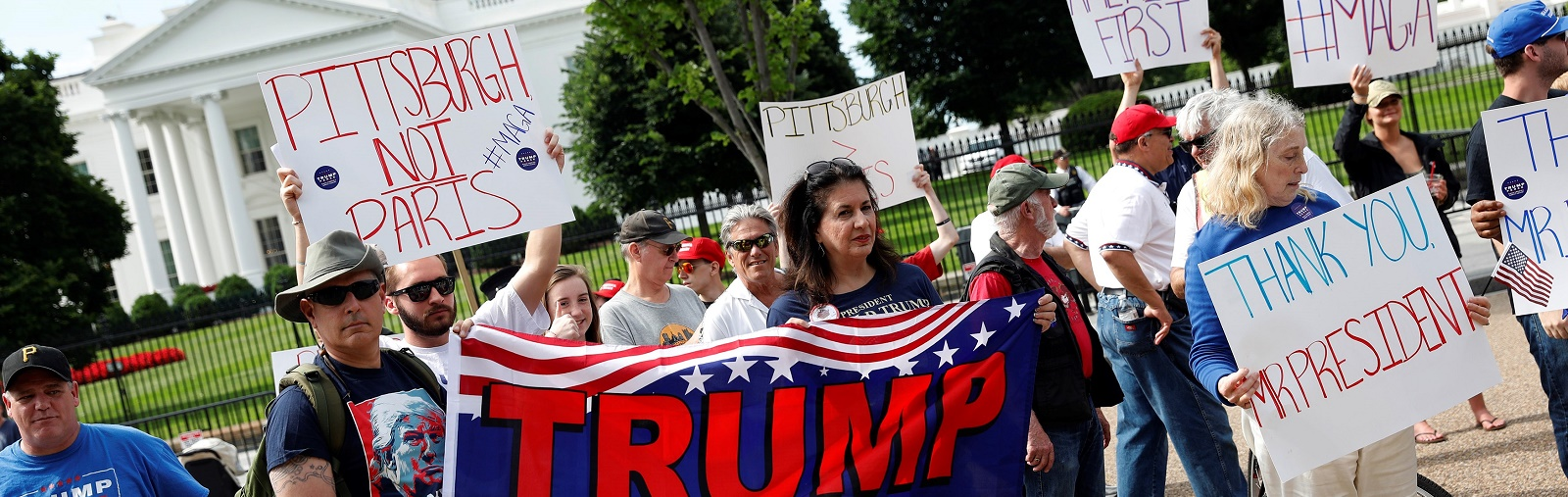 Supporters of US President Donald Trump and his policies at a 'Pittsburgh Not Paris' rally on Saturday. (Photo: Saul Loeb/Getty Images)