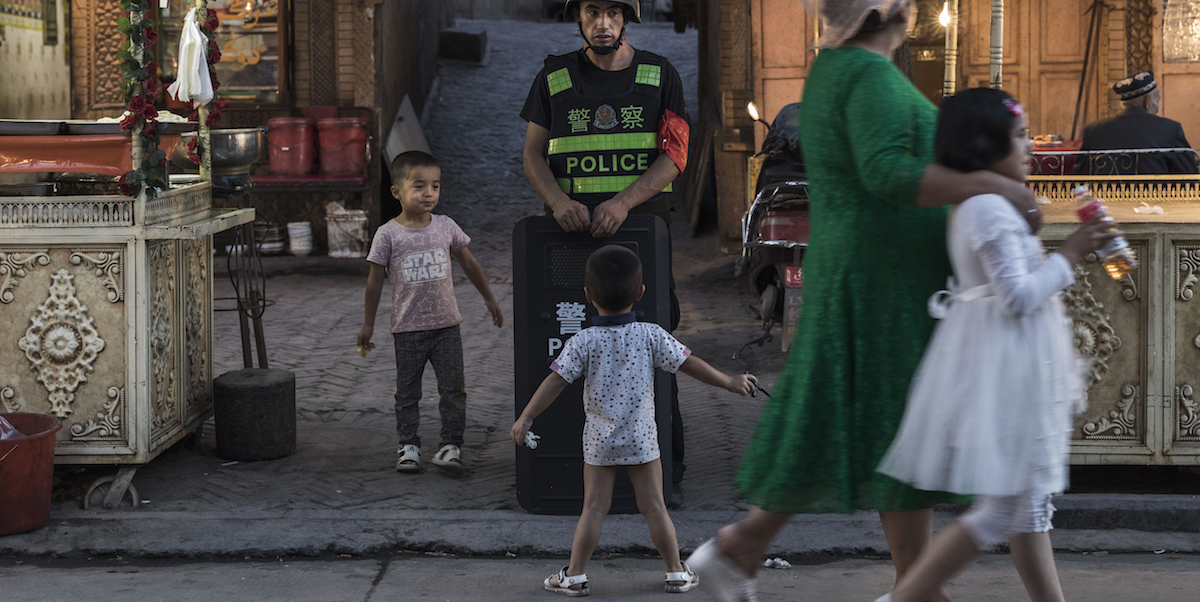 """In Xinjiang, Orwellian population controls have been increasingly scaled up since China launched its """"people's war on terror"""". (Photo: Kevin Frayer/ Getty)"""