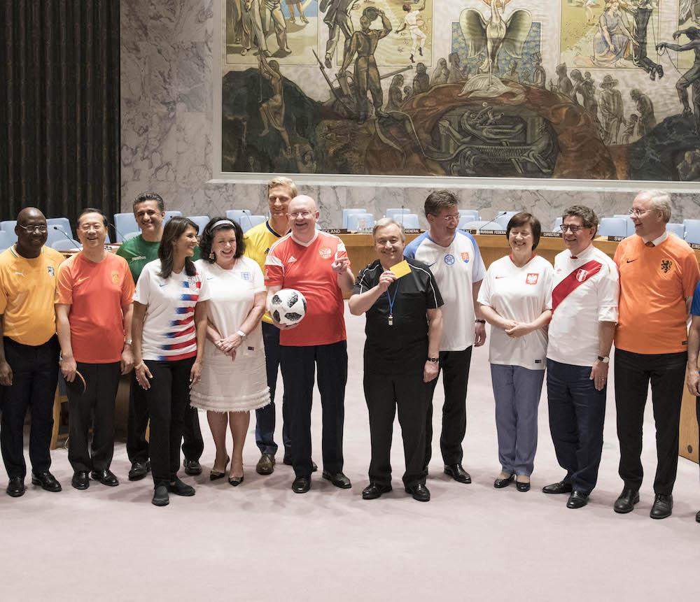 UN ambassadors in national team jerseys.