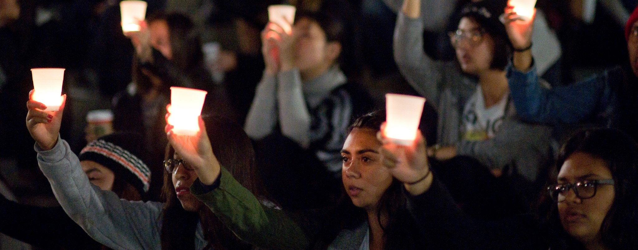 A candlelit vigil for victims of 2015 terrorist attacks in Paris, Beirut, and Baghdad. (Photo: Flickr/UCI)