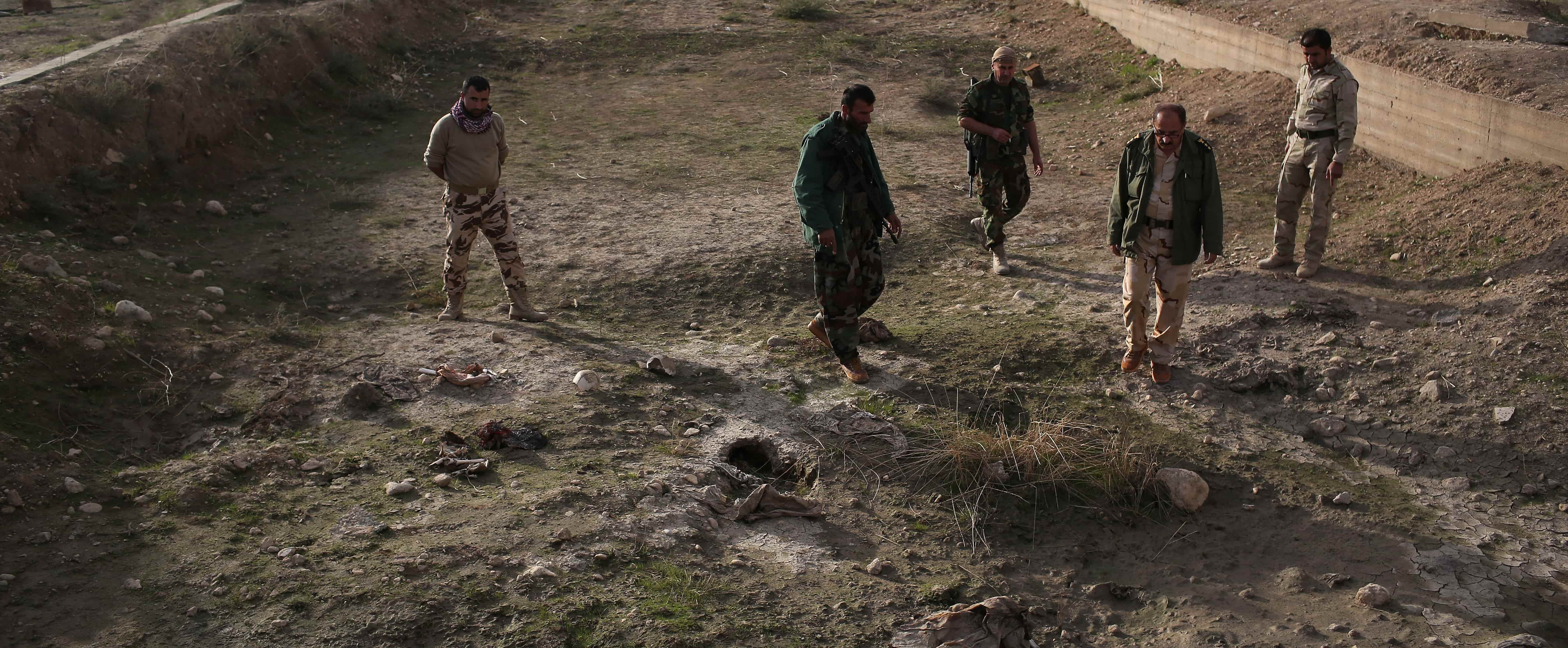 Kurdish Peshmerga show what they say is a mass grave of more than 50 Yazidis killed by ISIL on November 15, 2015 in Sinjar, Iraq. Photo: Getty Images/John Moore