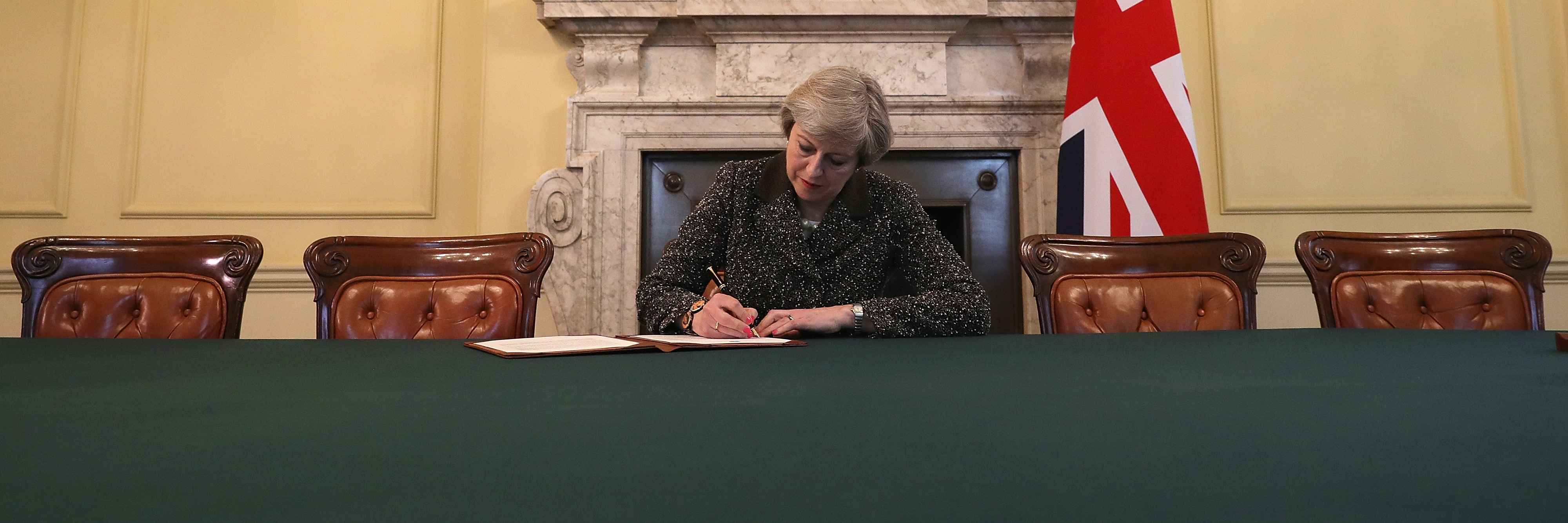 British Prime Minister Theresa May signing the letter to European Council President Donald Tusk invoking Article 50 (Photo: Getty Images/Christopher Furlong)