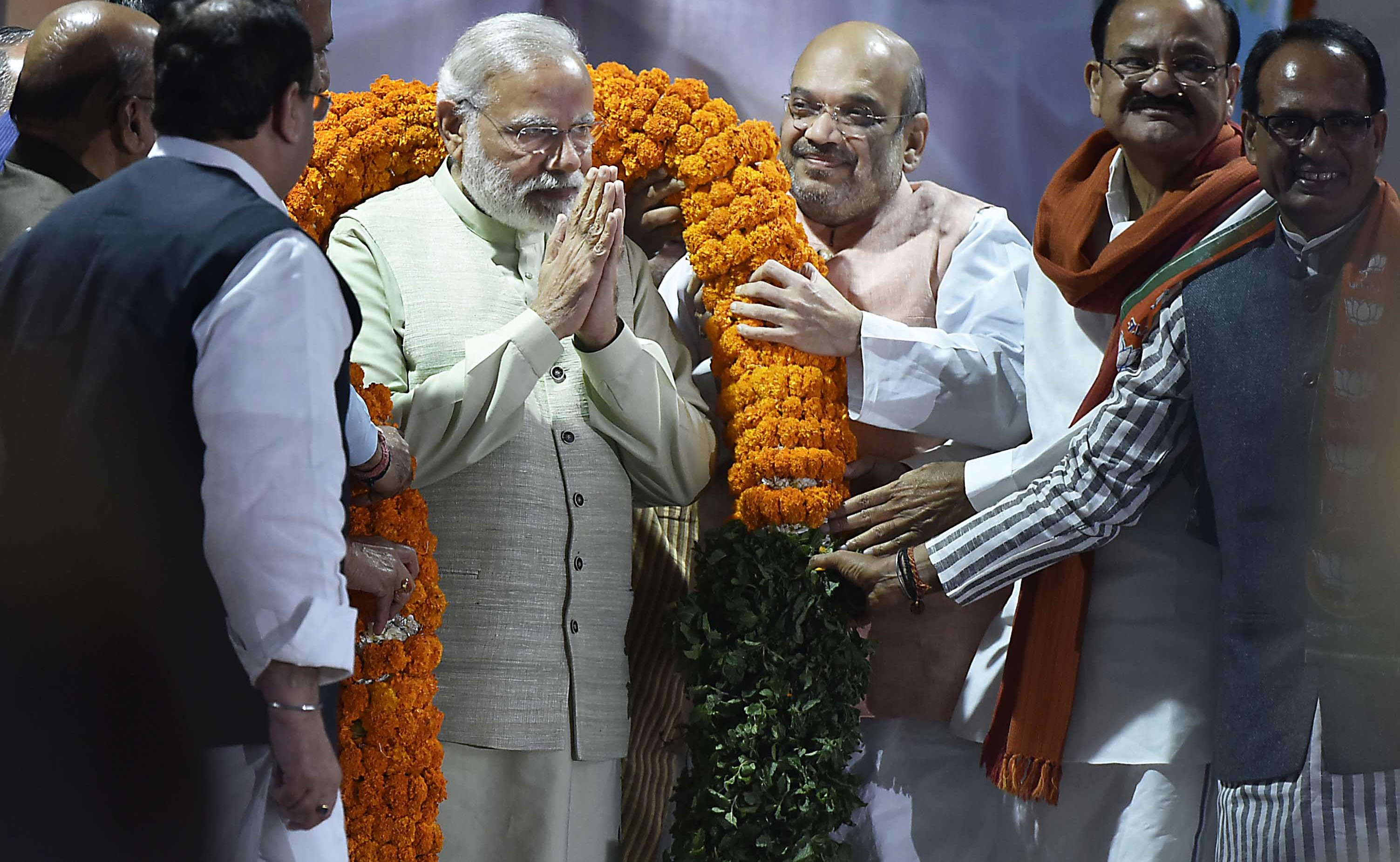 BJP leaders Amit Shah, Venkaiah Naidu, Shivraj Singh Chouhan and others greet Prime Minister Narendra Modi with a garland, March 2017 (Photo: Gtty Images/Hindustan Times/Raj K Raj)