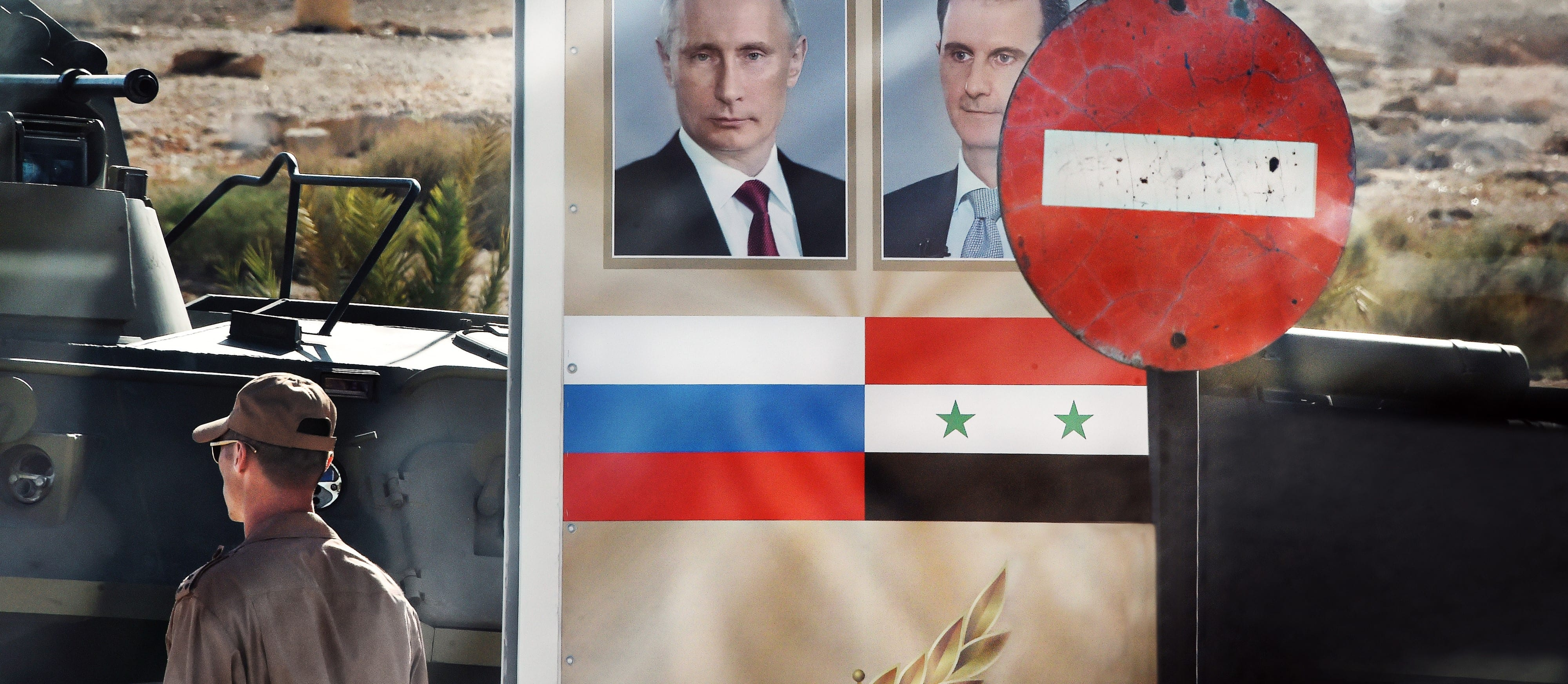 A sign featuring Russian President Vladimir Putin and Syrian President Bashar al-Assad in Palmyra, May 2016 (Photo: Getty Images/Kommersant Photo)