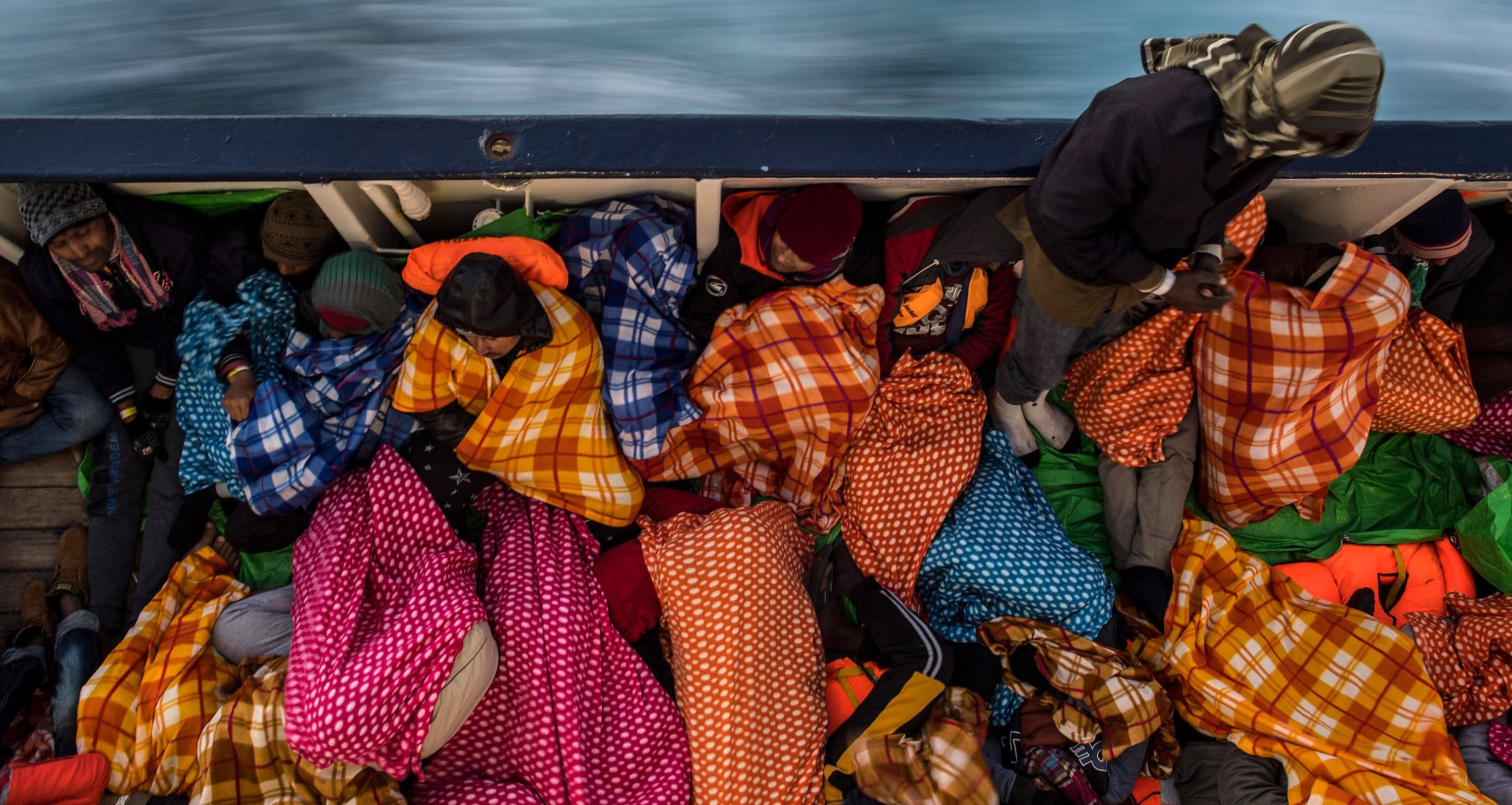 Migrants and asylum seekers on the deck of a Spanish rescue vessel in the Mediterranean, February 2017 (Photo: Getty Images/David Ramos)