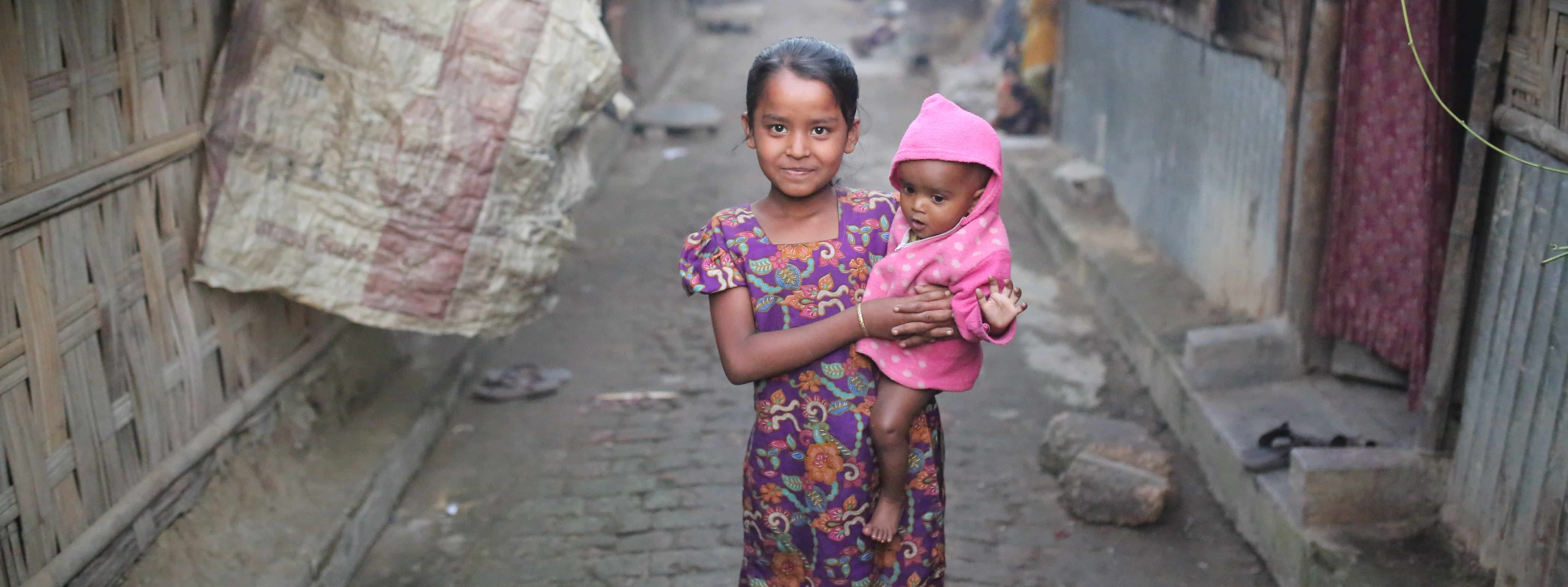Two children in a unregistered Rohingya camp in Bangladesh, December 2016. Photo: Getty Images/Anadolu Agency