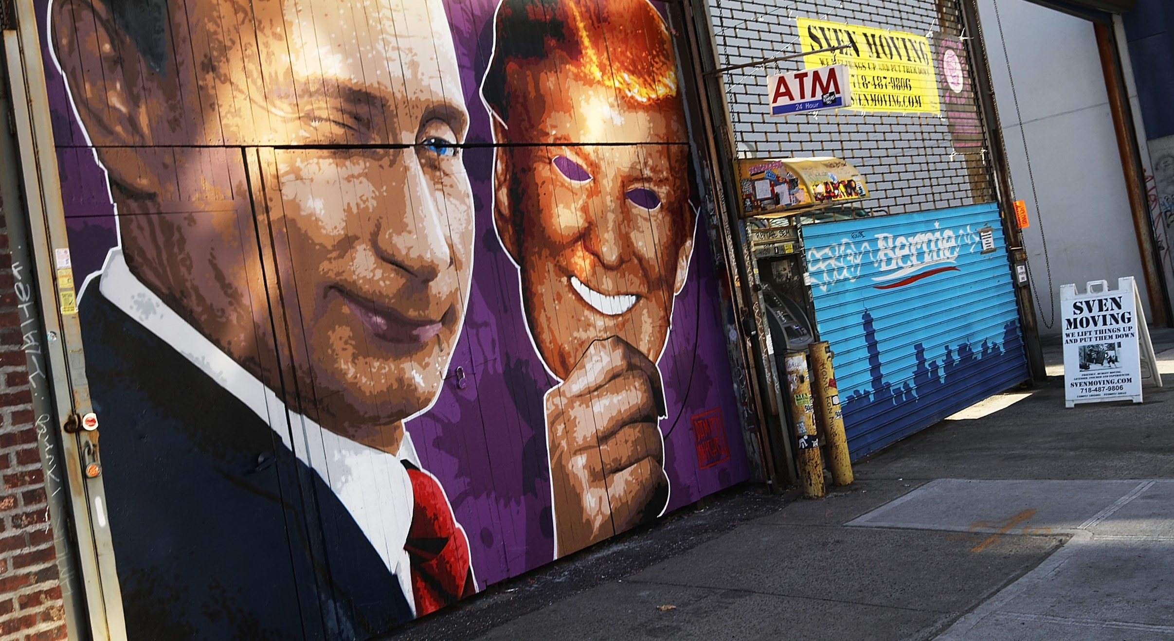 A mural depicting Vladimir Putin taking off a Donald Trump mask, New York, 2017 (Photo: Getty Images/Spencer Platt)