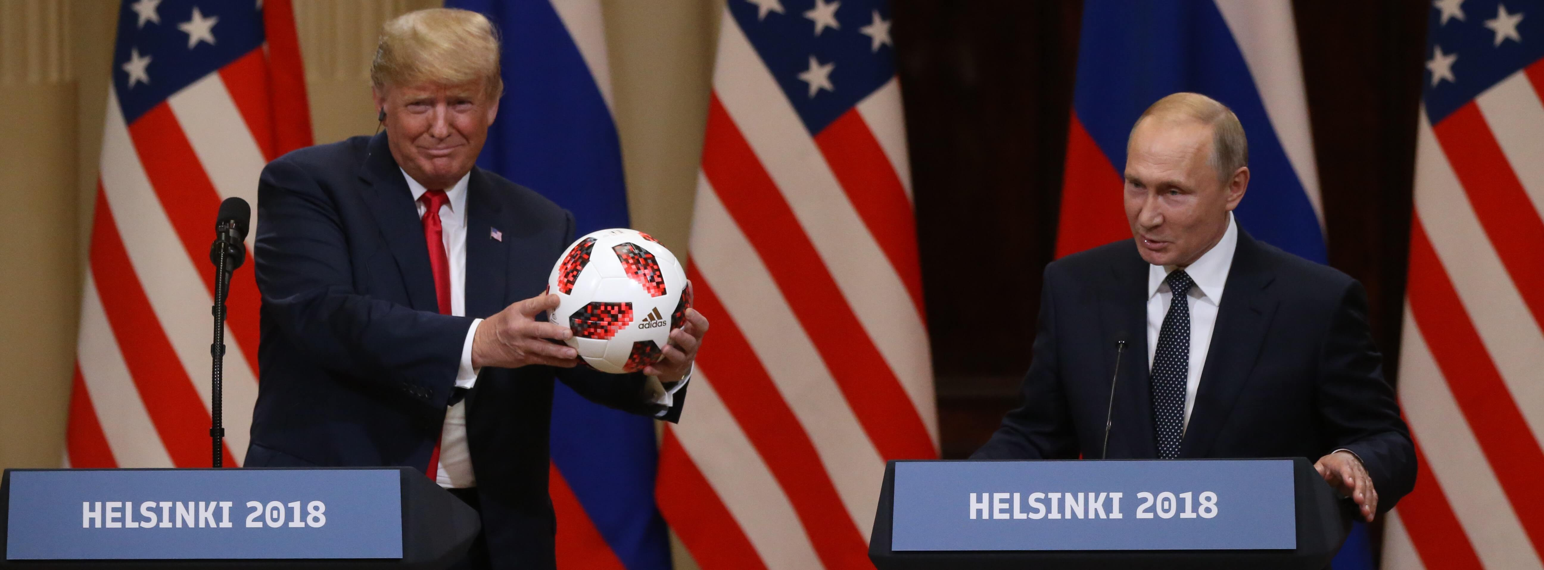 Russian President Vladimir Putin gives US President Donald Trump a football after their summit in Helsinki (Photo: Mikhail Svetlov/Getty)