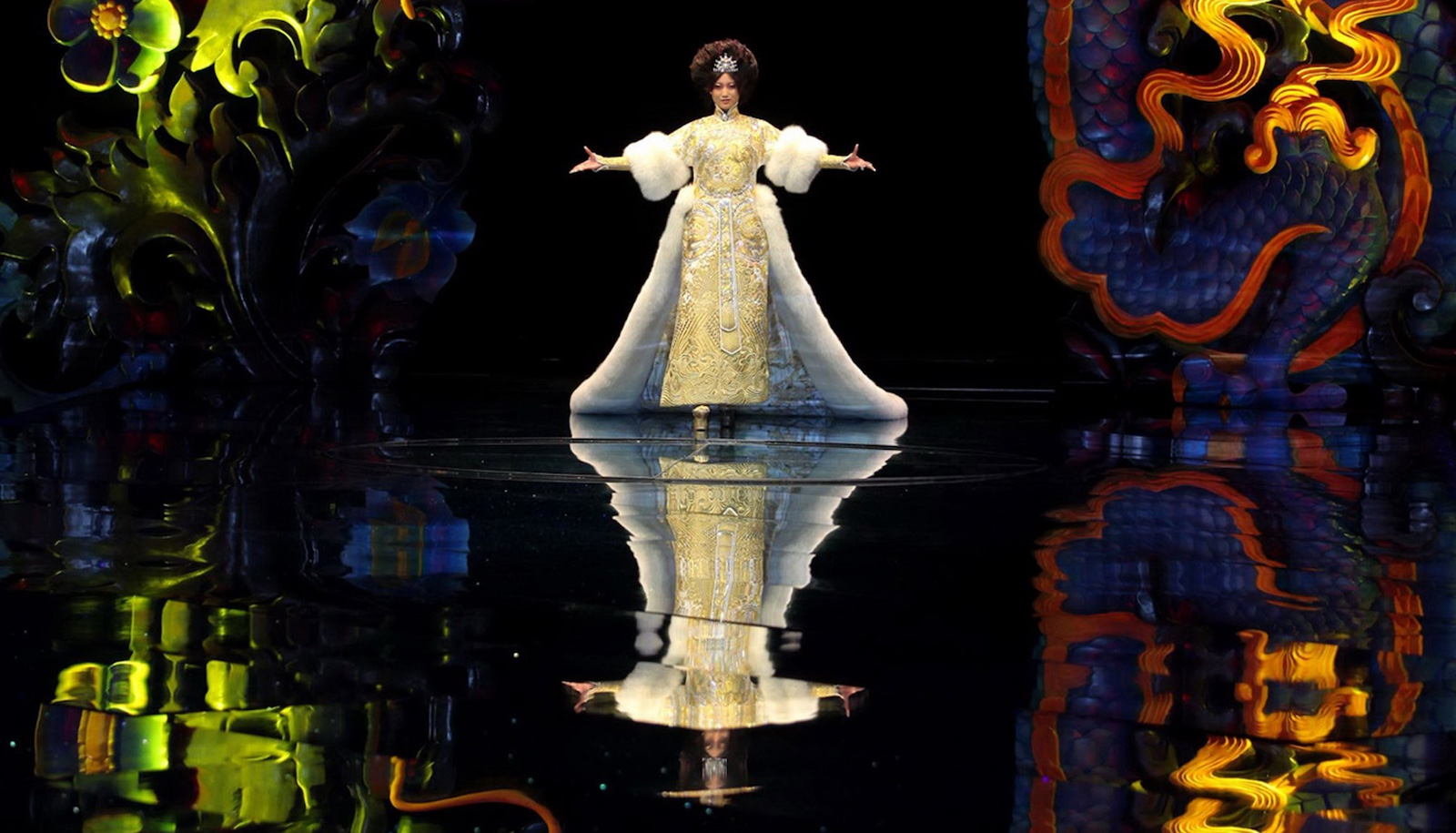 A model showcases designs on the runway during the Guo Pei 2013 Dragon Bride show in Beijing, China (Photo: VCG/Getty)