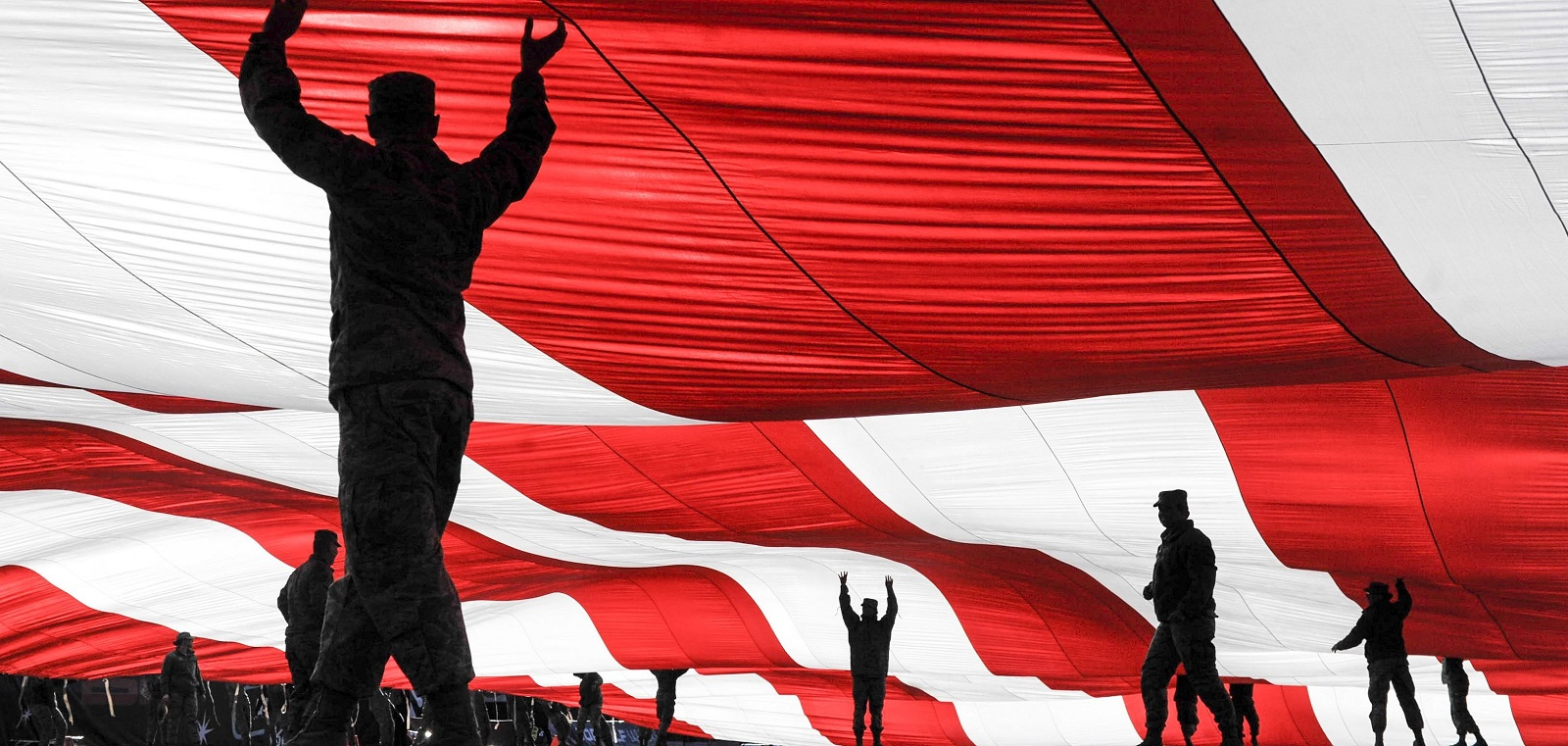 US Airmen hold up an American flag in Nevada, December 2016 (Photo: US Dept of Defense)