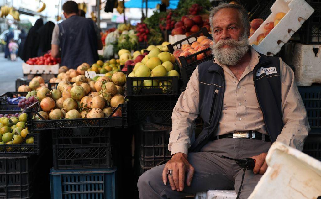 A fruit-seller in the north-western Syrian city of Idlib. (Getty/Omar Haj Kadour)