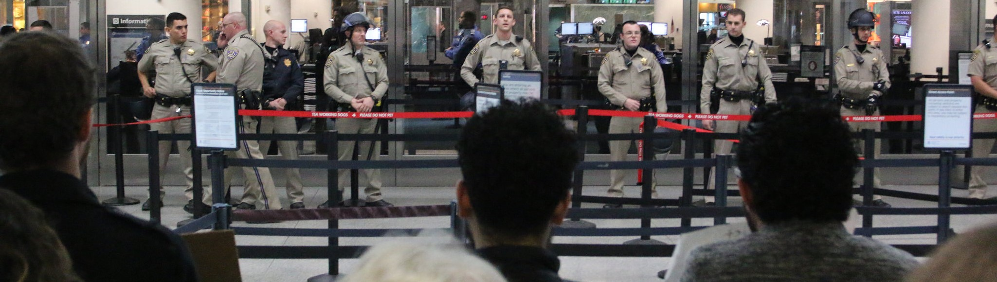 Holding the line against travel ban protesters at San Francisco International Airport (Photo: Flickr user Quinn Norton)