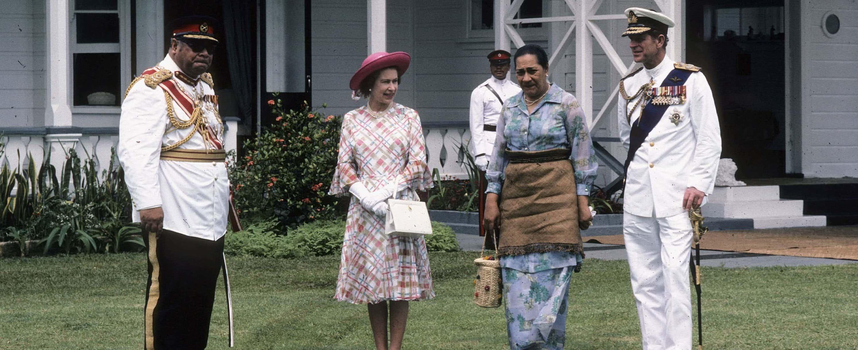 Tongan King Taufa'ahau Tupou lV and Queen Halaevalu Mataʻaho Ahomeʻe meet Queen Elizabeth ll and Prince Philip, Tonga, 1977. (Photo: Anwar Hussein Collection/Getty)