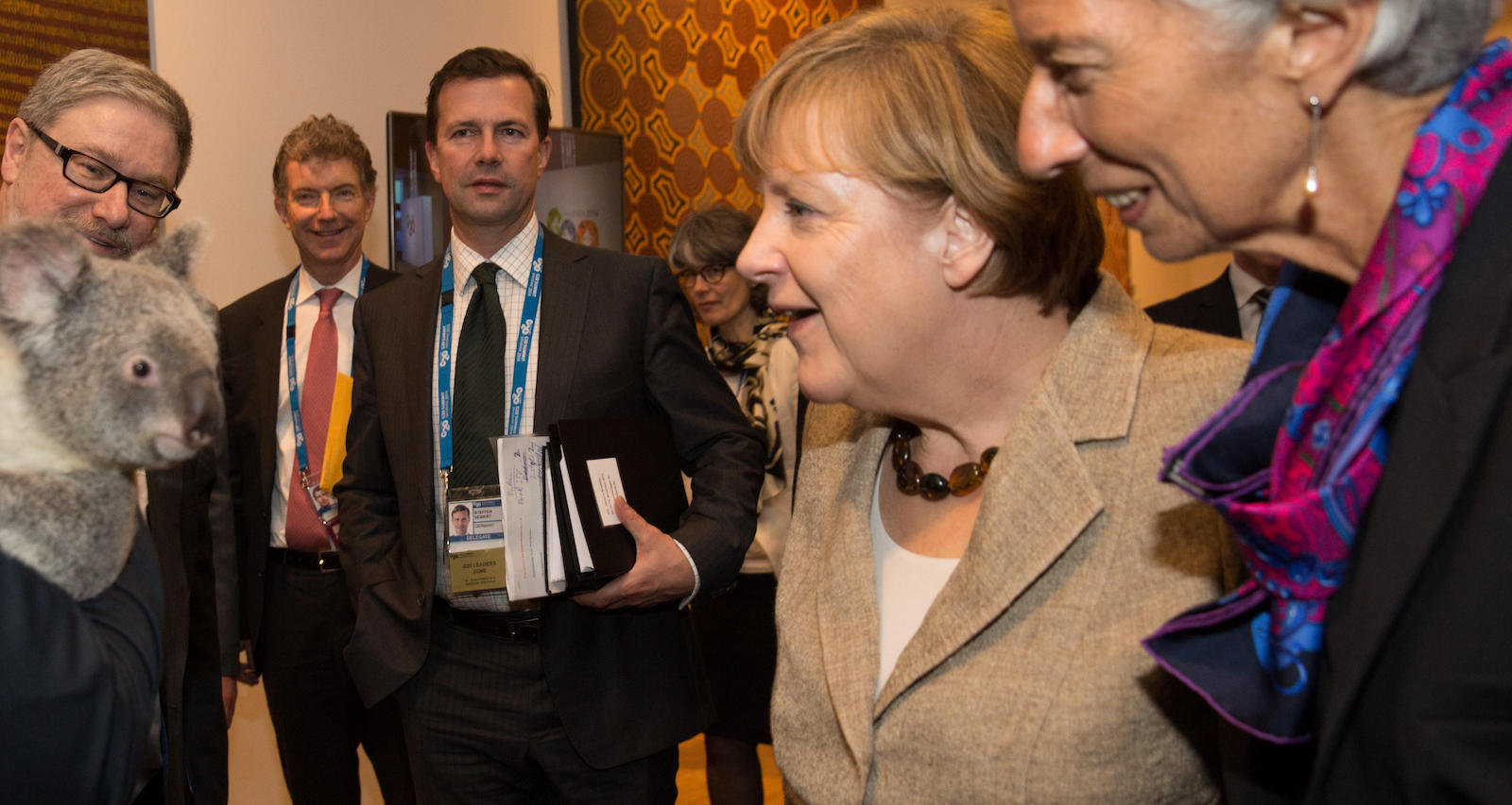 Germany's Chancellor Angela Merkel and IMF President Christine Lagarde meet a local at the G20 (Photo: Andrew Taylor/Getty Images)