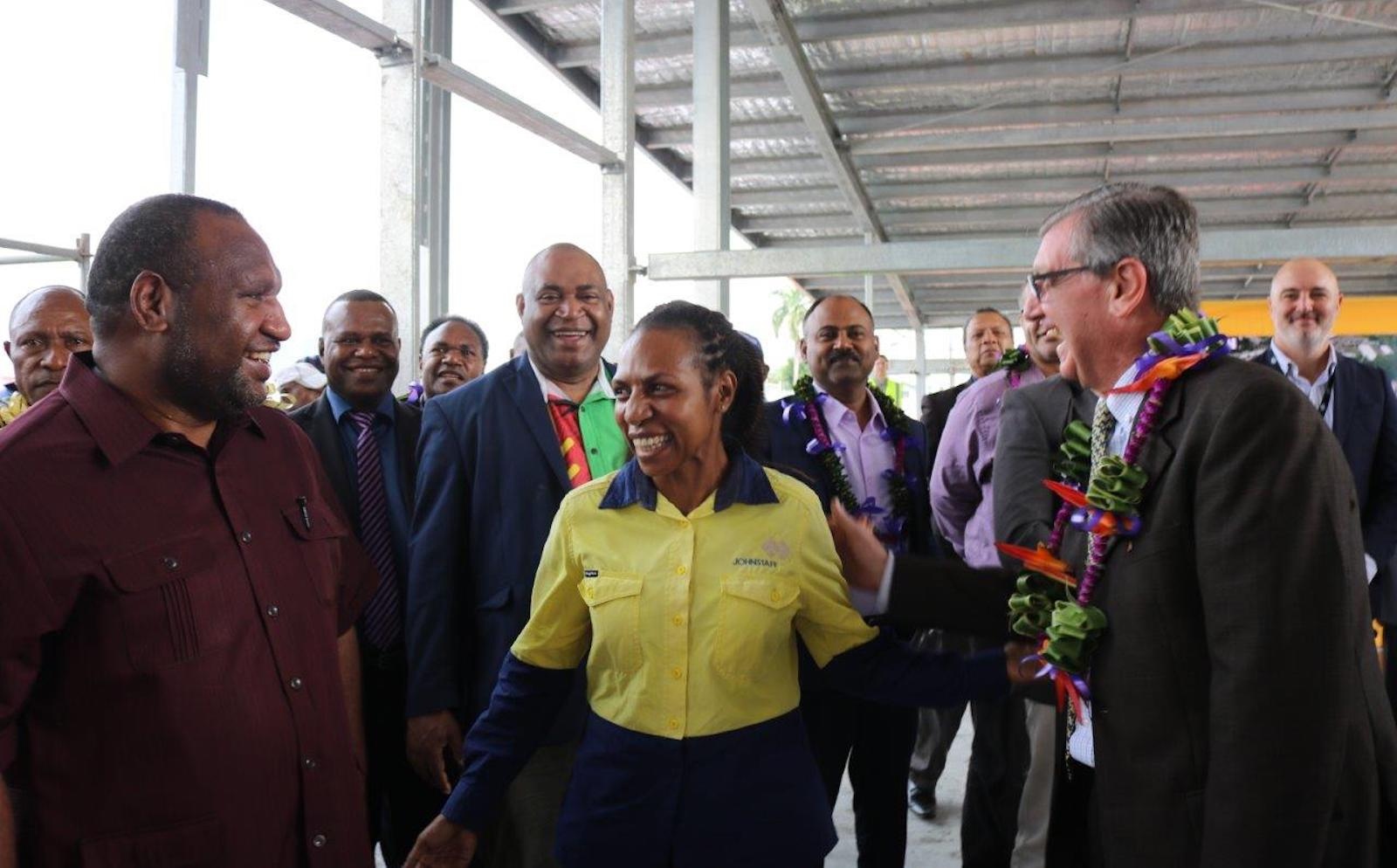 Women show themselves as leaders in PNG's development despite a lack of reflection in politics. Melinda Kanamon briefs on the Angau Redevelopment Project to PM James Marape and Australian High Commissioner Bruce Davis (Photo: Johnstaff International)
