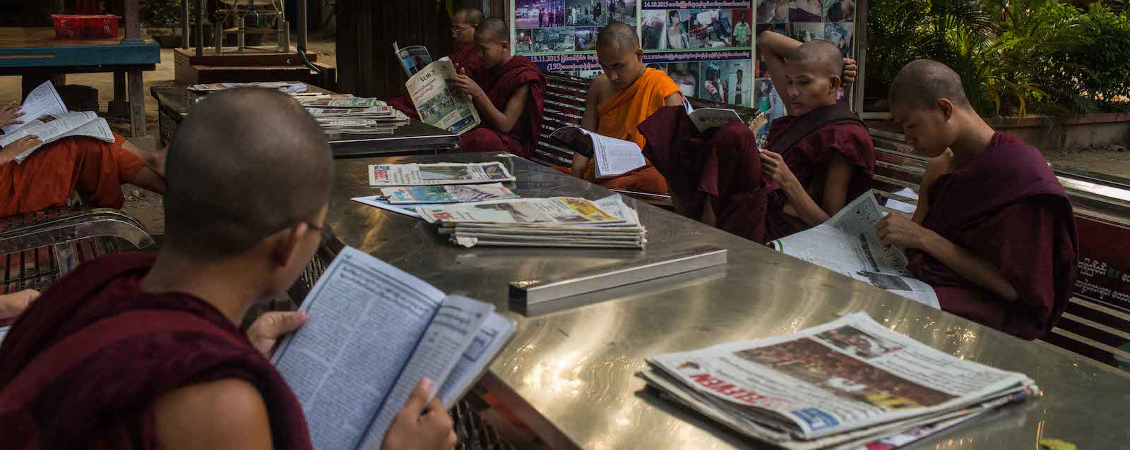 Monks at the Masoeyein Monastery read newspapers in Mandalay, (Photo: Lauren DeCicca/Getty)