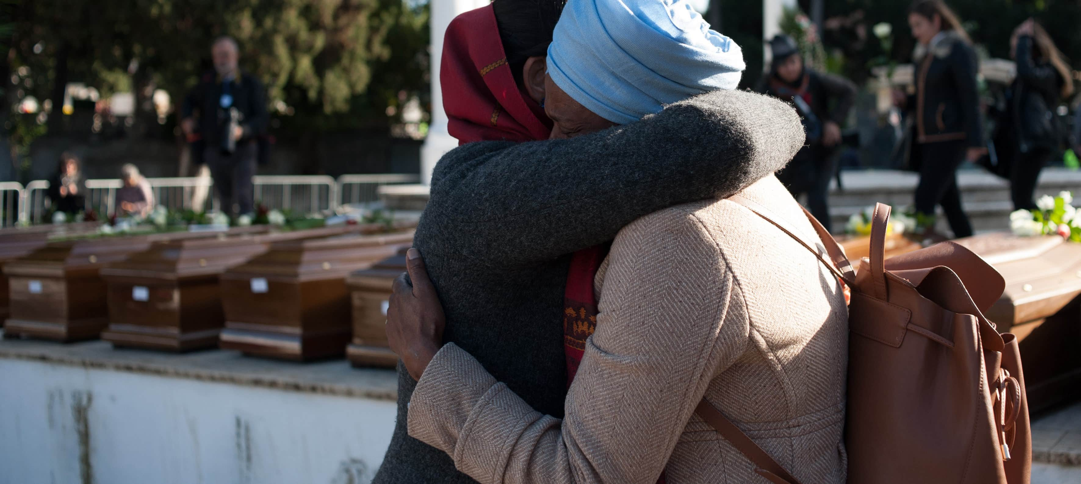 A funeral for 26 migrant women and girls who drowned attempting to cross the Mediterranean, November 2017 (Photo: Ivan Romano/Getty Images)