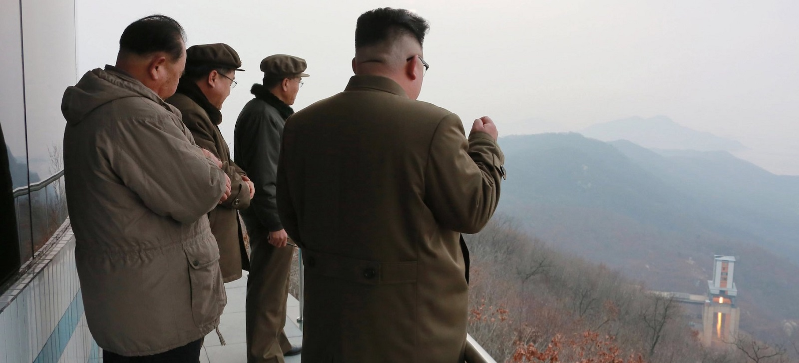 This picture released by North Korea's Korean Central News Agency on 19 March shows North Korean leader Kim Jong-Un at a test of a high-thrust engine at a satellite launching ground.